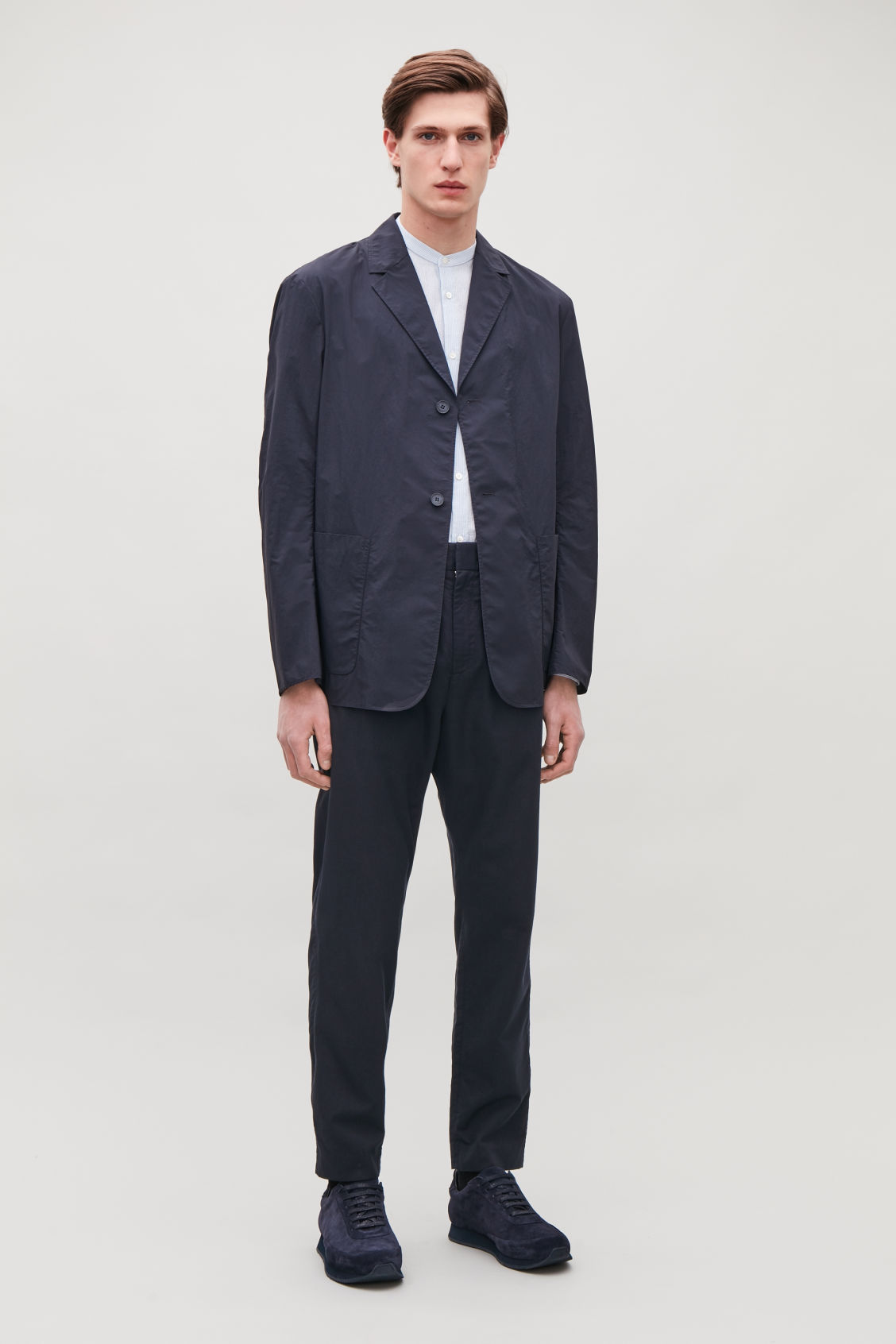 Model side image of Cos tailored trousers with elastic waist in blue
