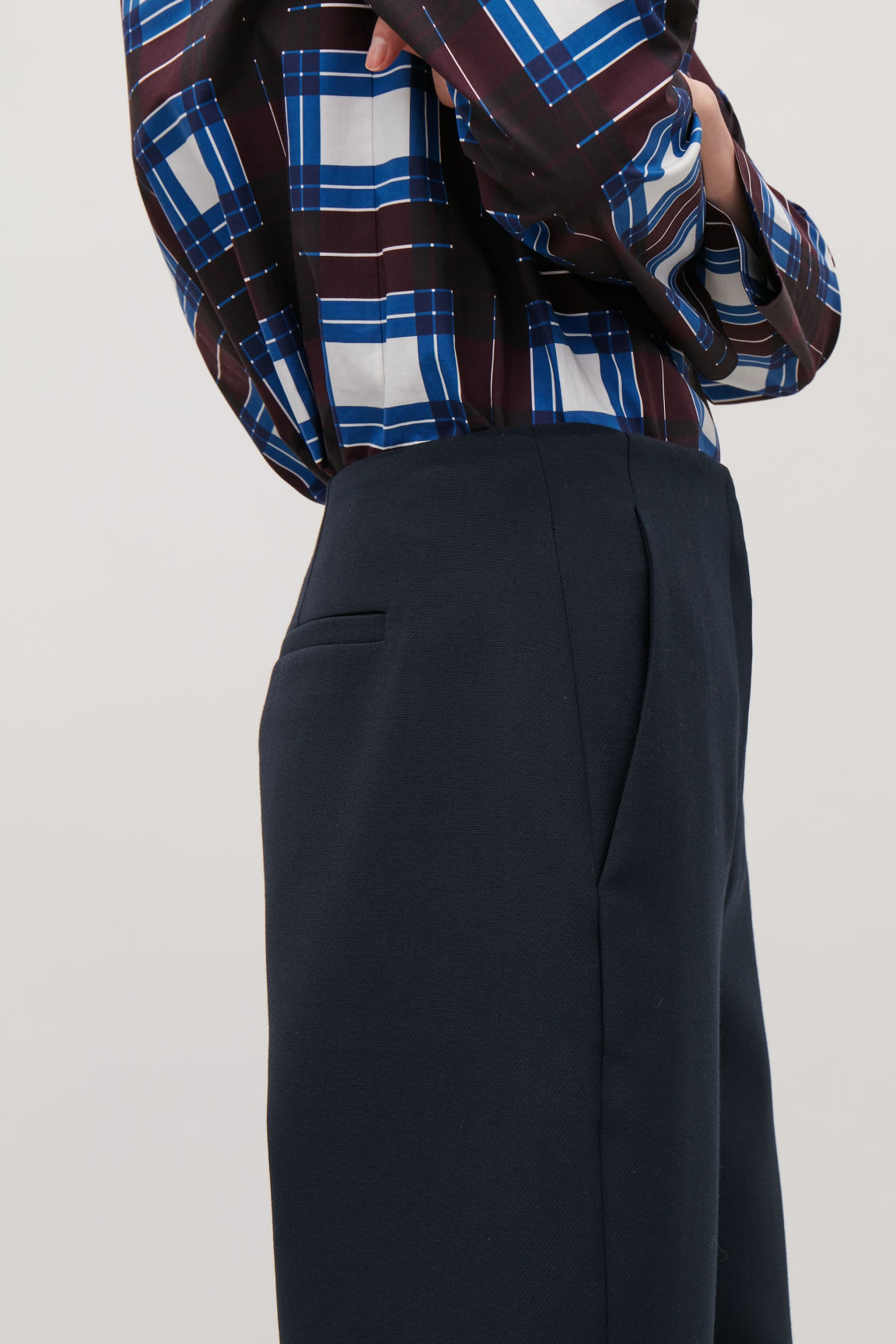 Model side image of Cos twisted-seam trousers in blue