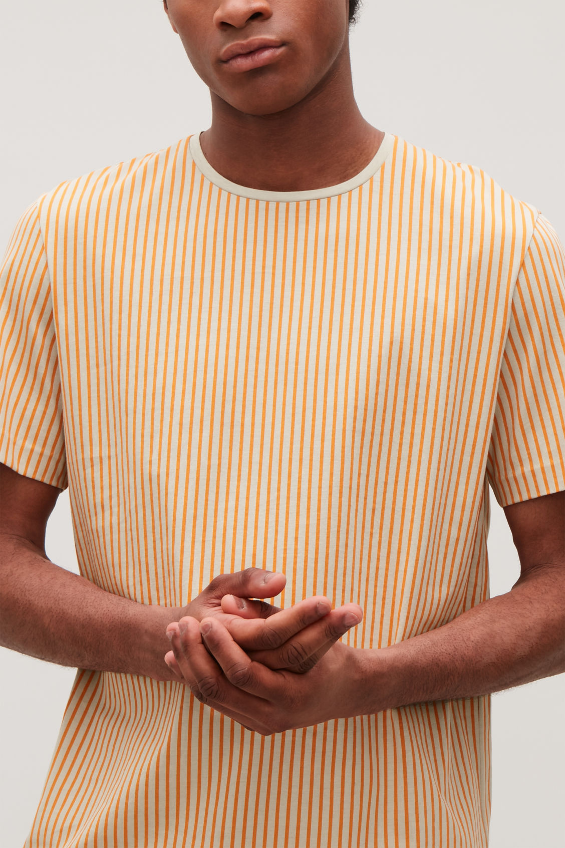 Model side image of Cos fine-striped cotton t-shirt in orange