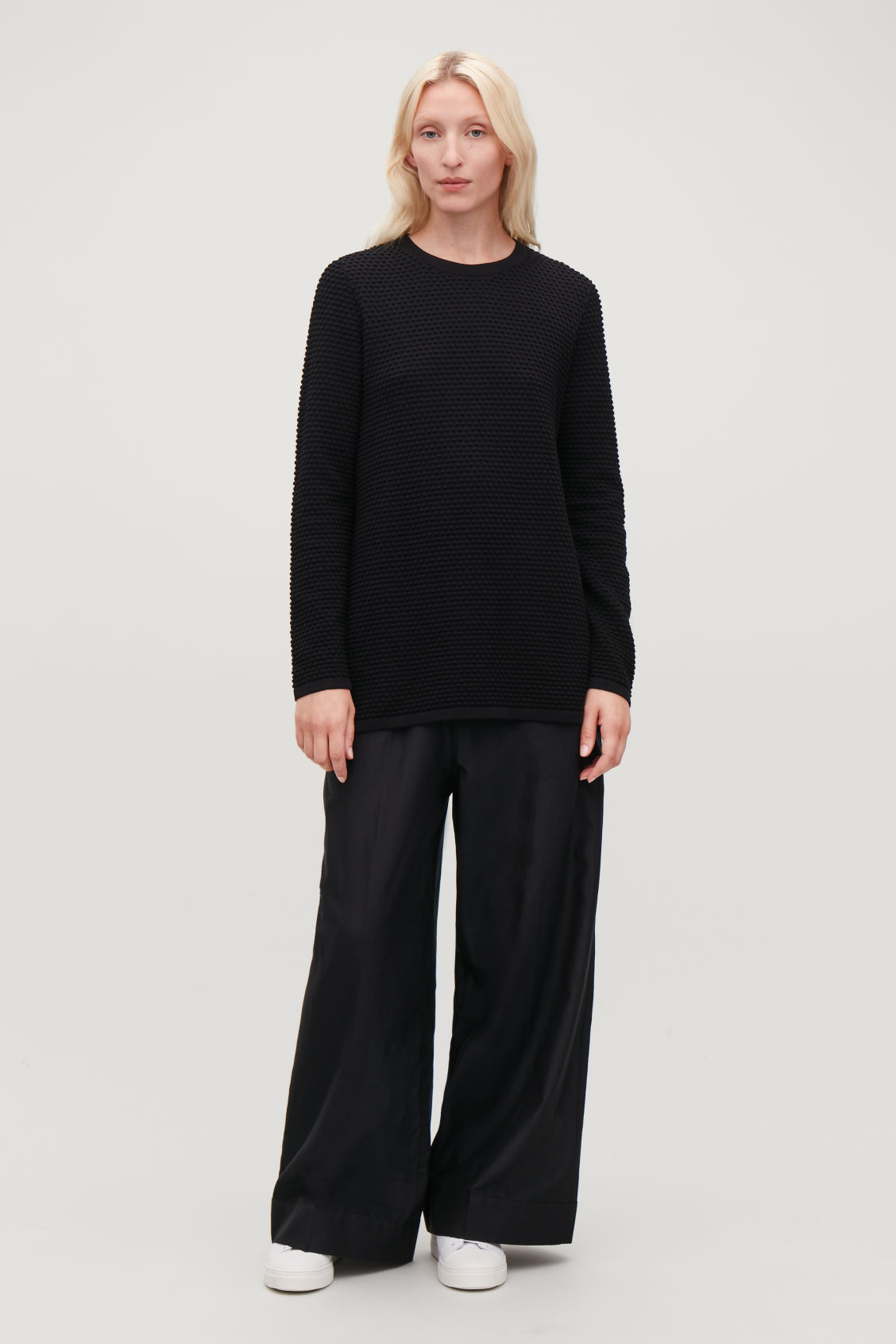 Model front image of Cos textured a-line top in black
