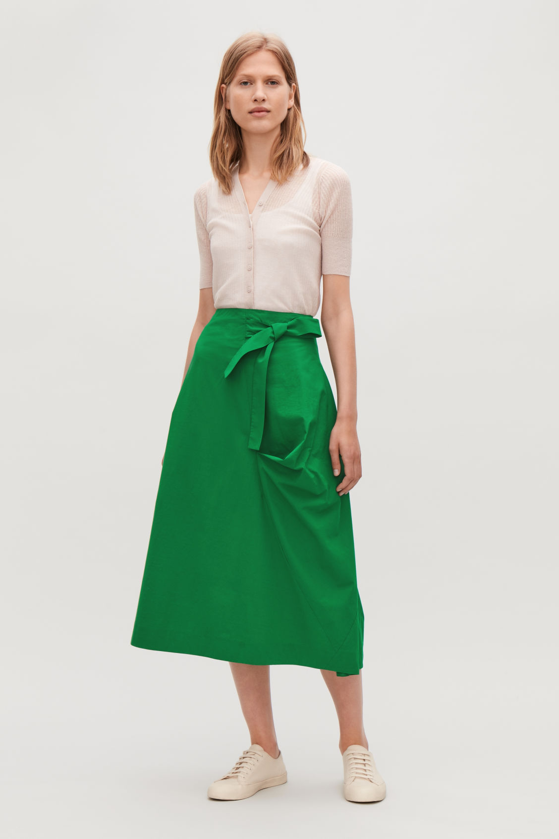 Model side image of Cos a-line wrap-over skirt in green