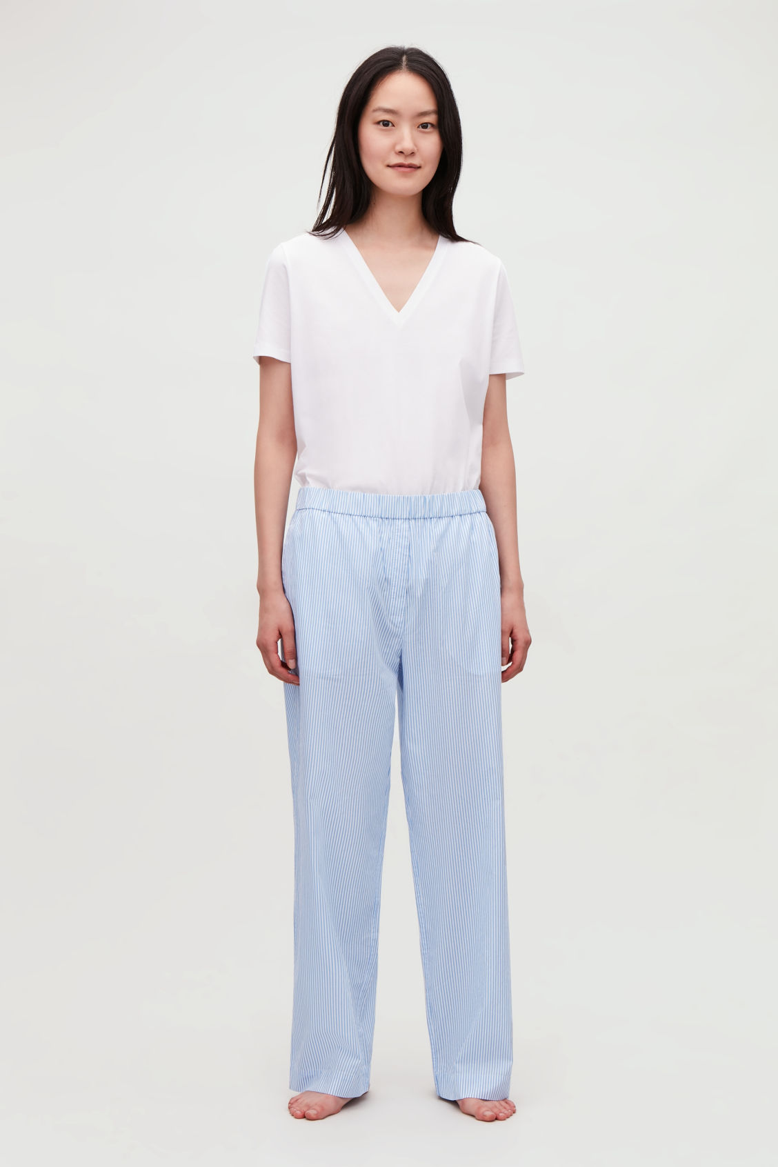Model front image of Cos striped cotton pyjama trousers  in blue