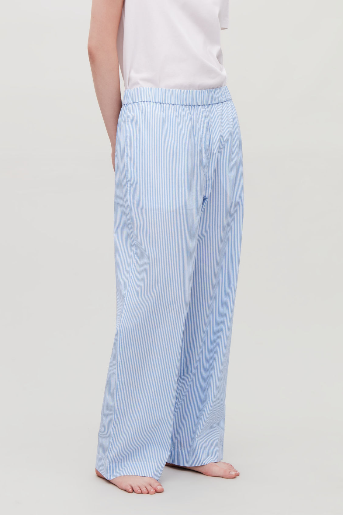 Model side image of Cos striped cotton pyjama trousers  in blue