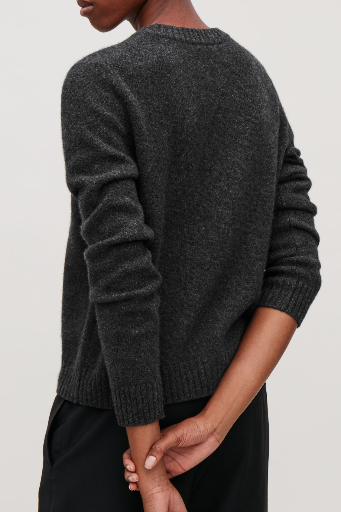 Model side image of Cos round-neck cashmere jumper  in grey