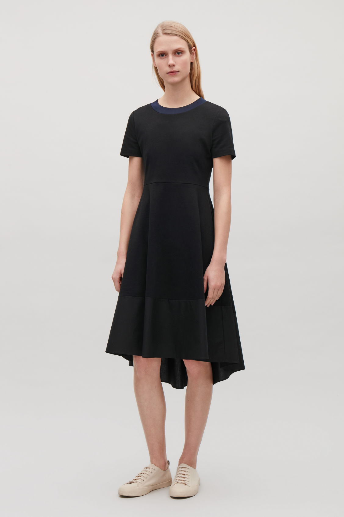 Model front image of Cos panelled jersey dress in black