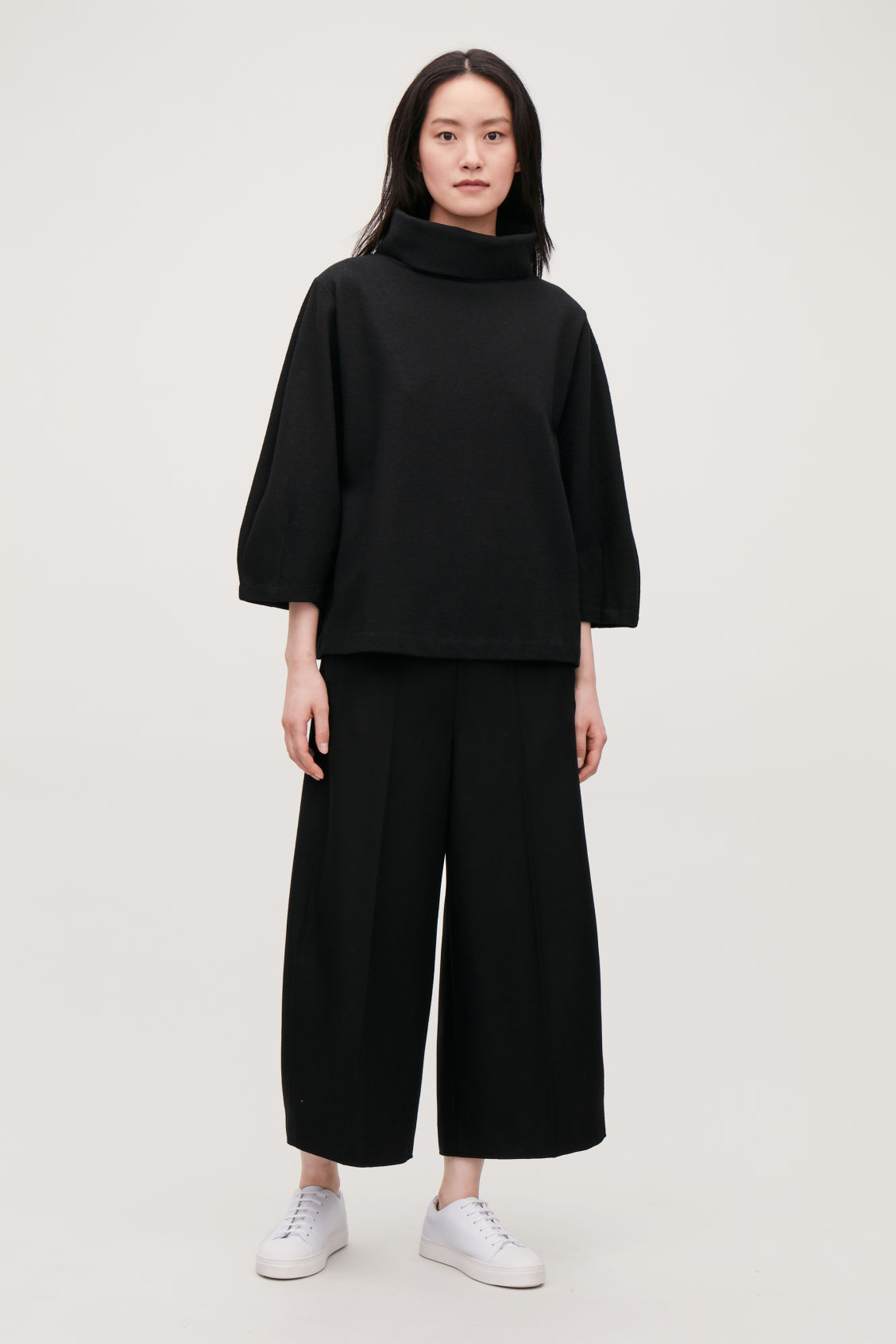 Model front image of Cos jersey wool top with cocoon sleeves  in black