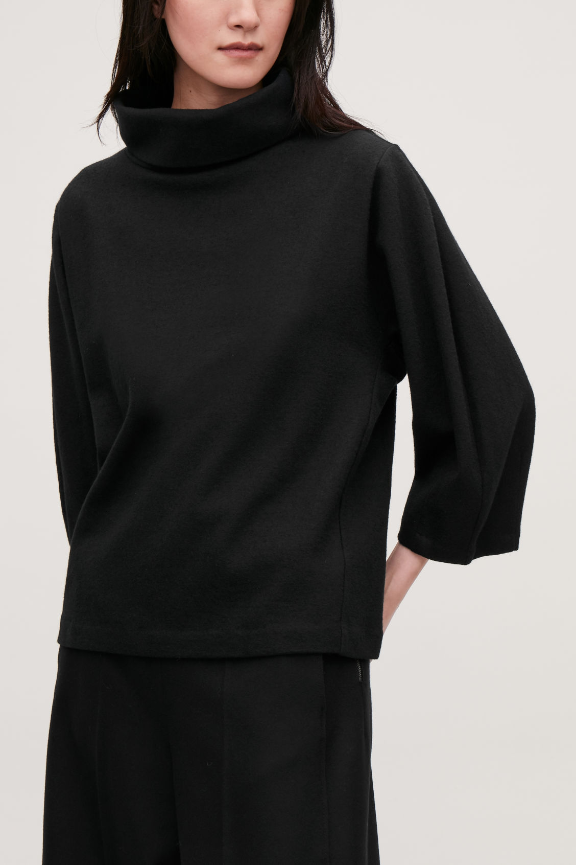 Model side image of Cos jersey wool top with cocoon sleeves  in black
