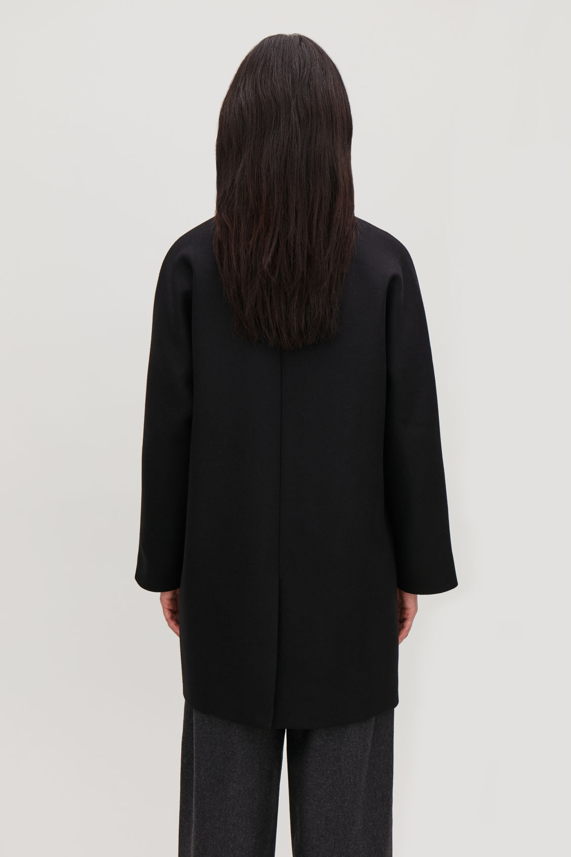 Model side image of Cos single-breasted wool coat  in black