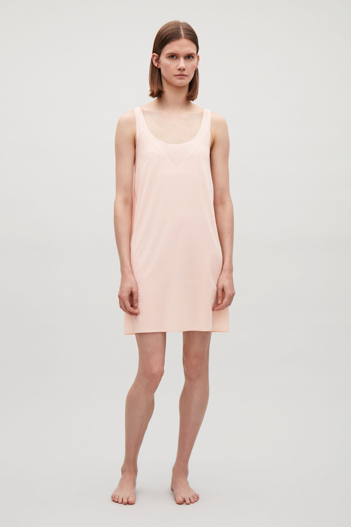 Model front image of Cos seamless slip dress  in beige