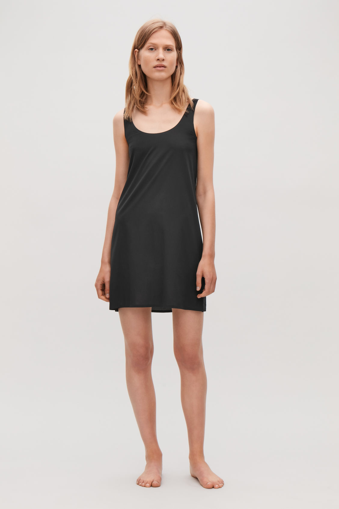 Model front image of Cos seamless slip dress  in black