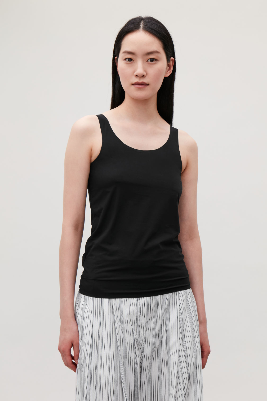 Model side image of Cos seamless vest top  in black