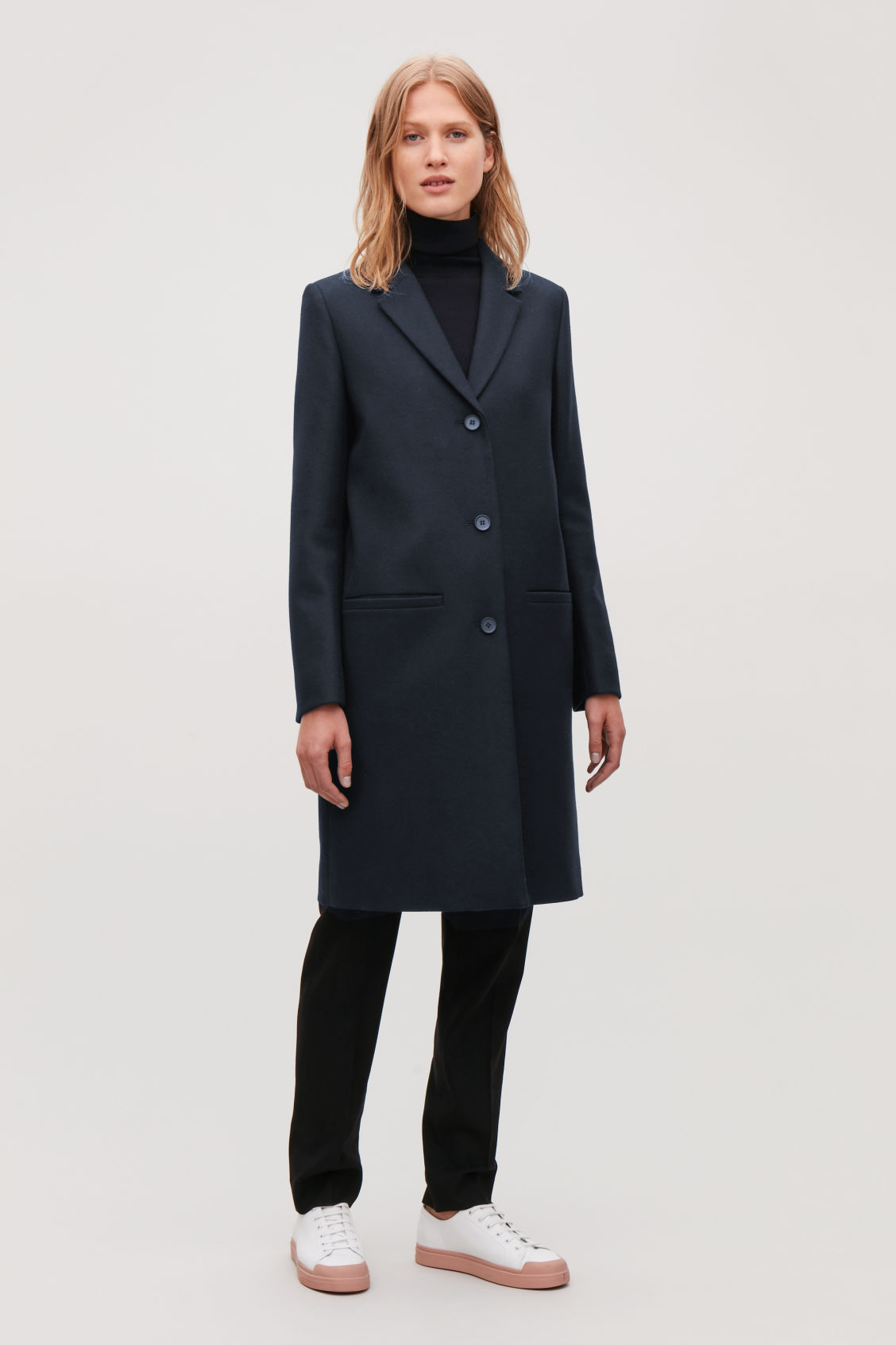 Model side image of Cos tailored wool coat in blue