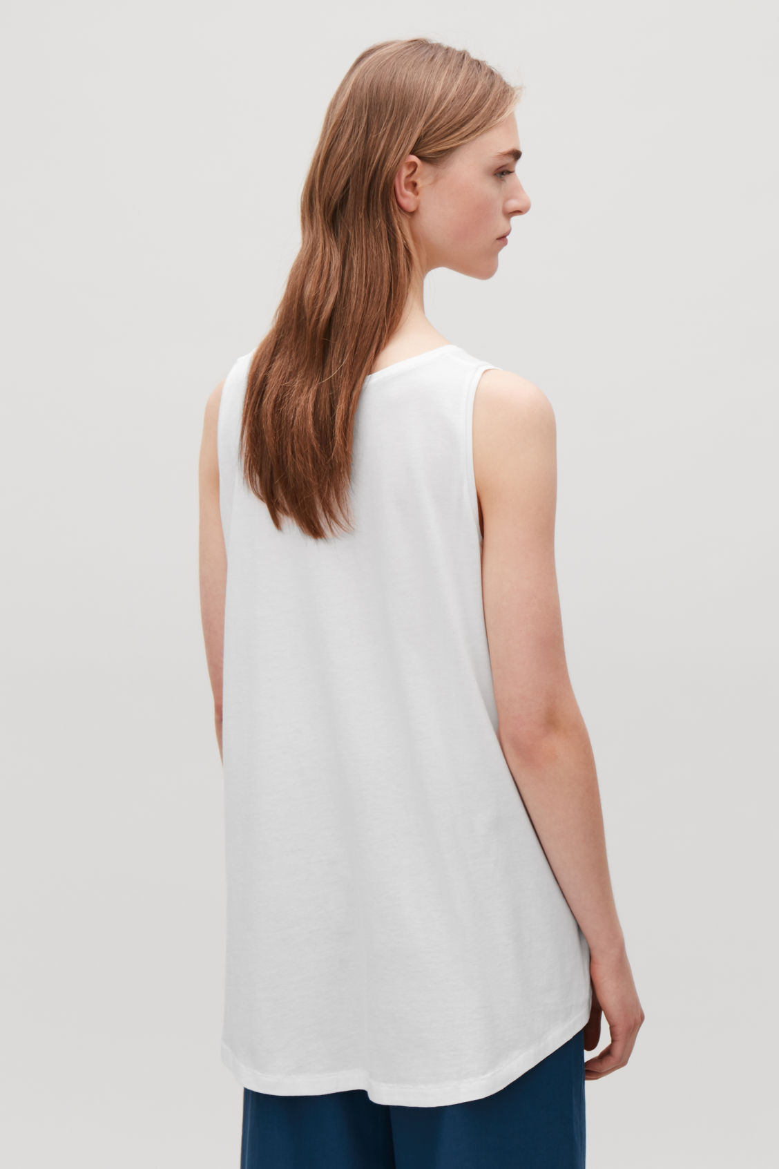 Model side image of Cos flared cotton vest in white