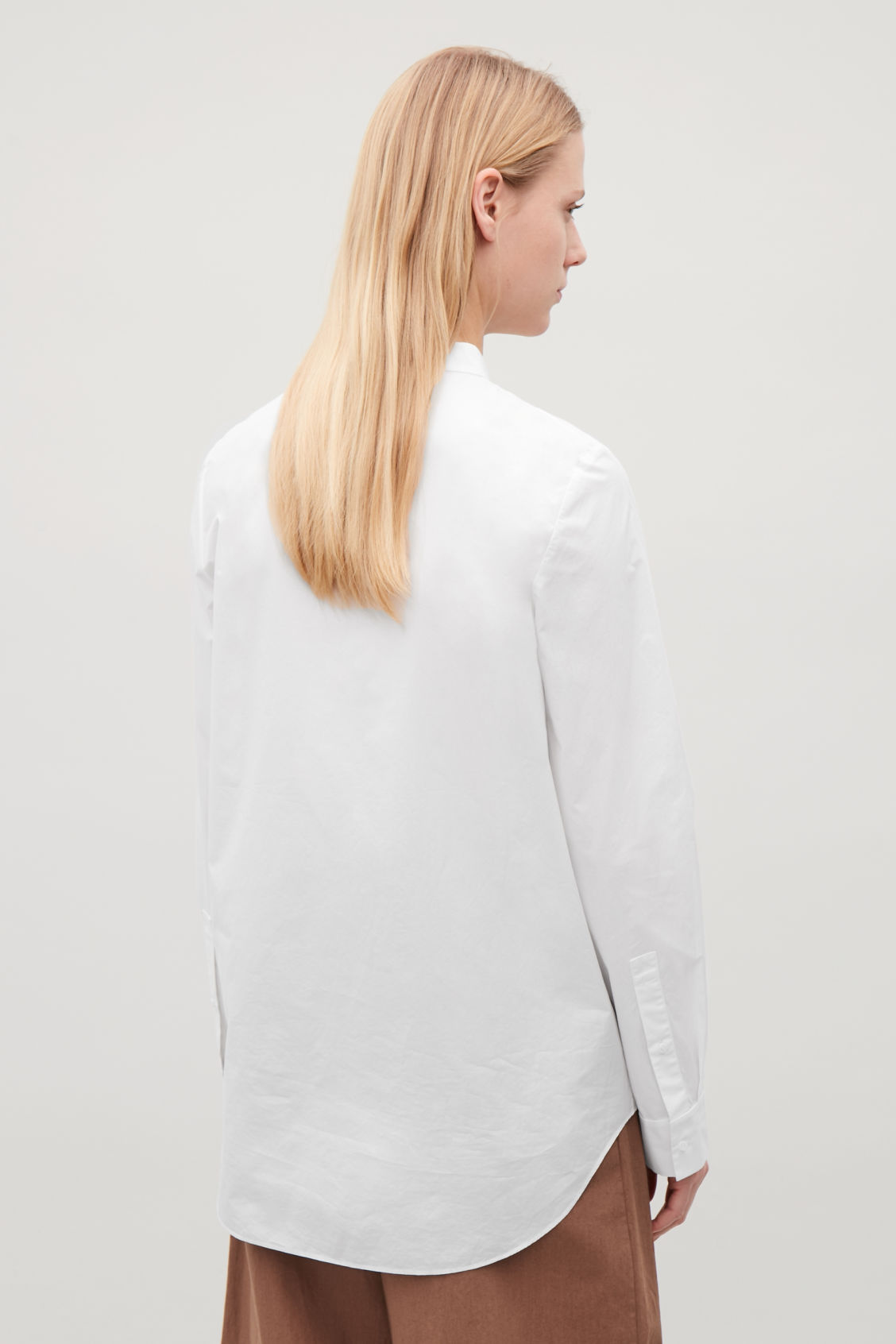 Model side image of Cos grandad-collar shirt in white