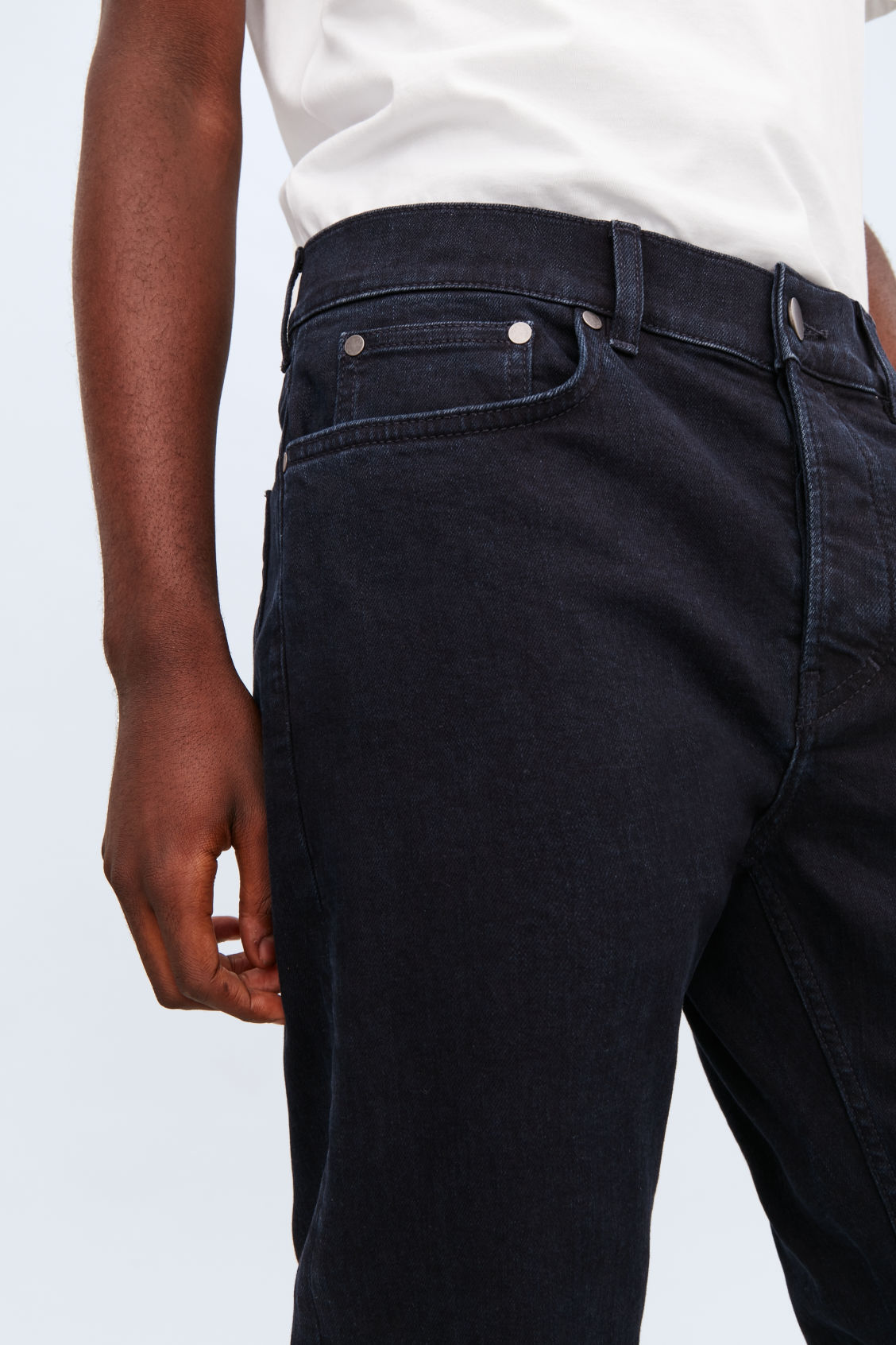 Model side image of Cos slim tapered jeans in blue