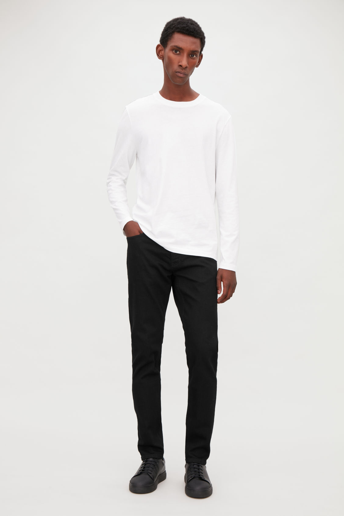 Model front image of Cos slim tapered jeans in black