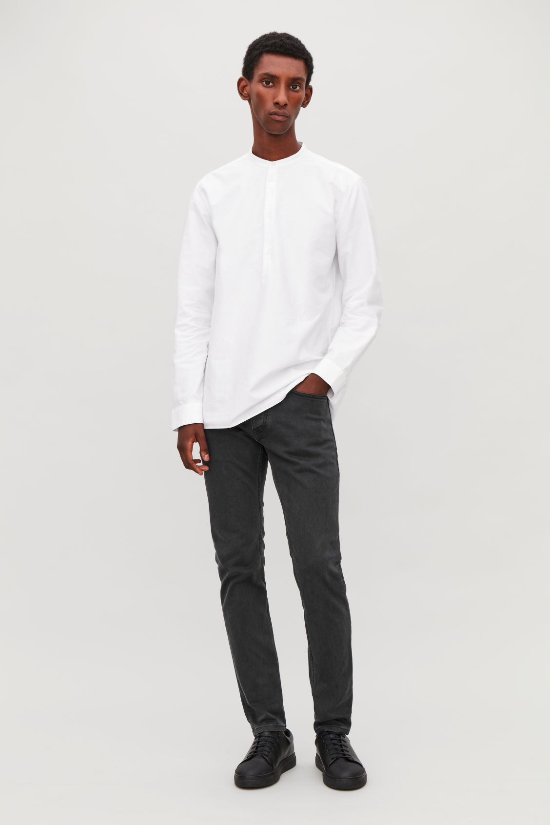 Model front image of Cos slim tapered jeans in grey
