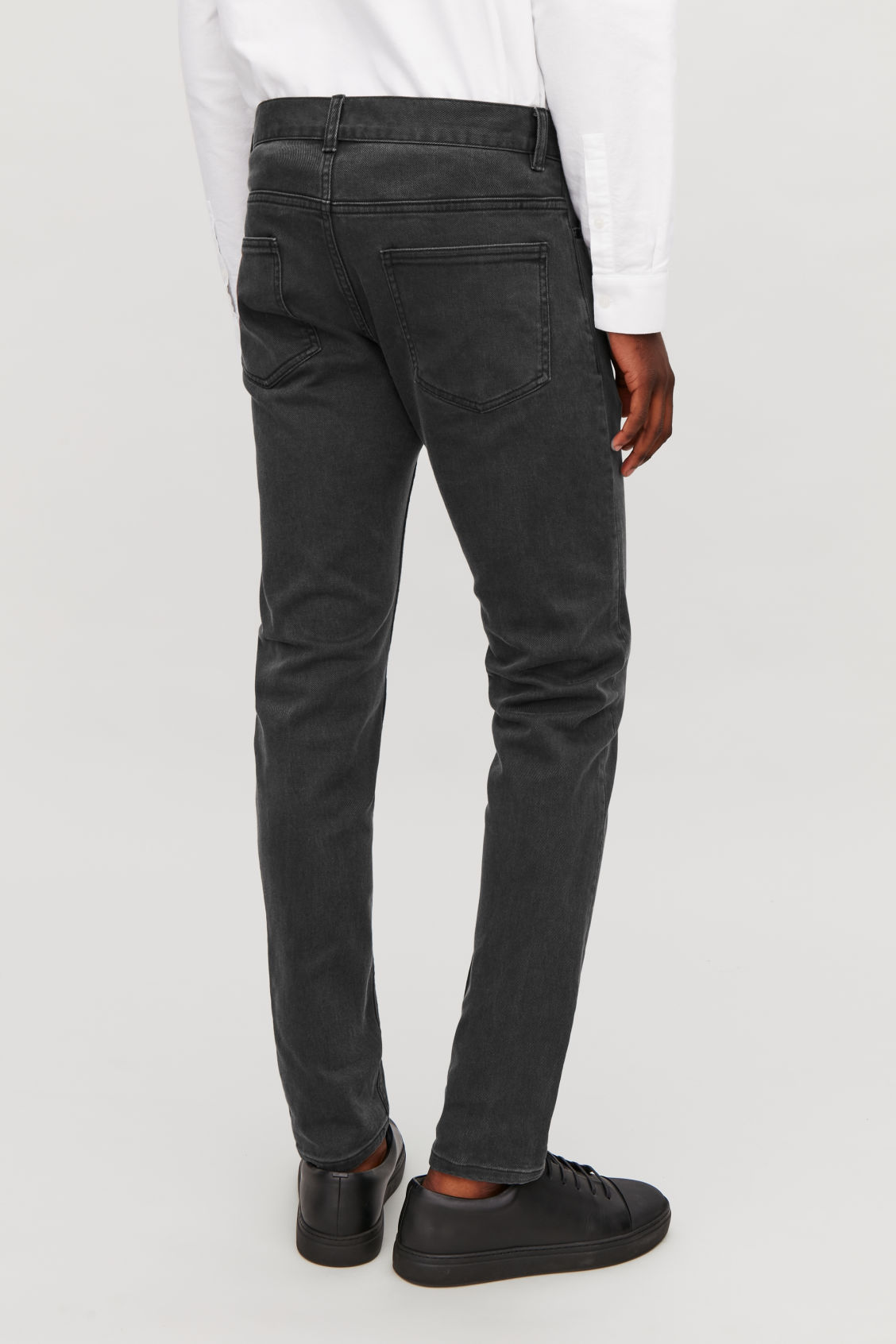 Model side image of Cos slim tapered jeans in grey
