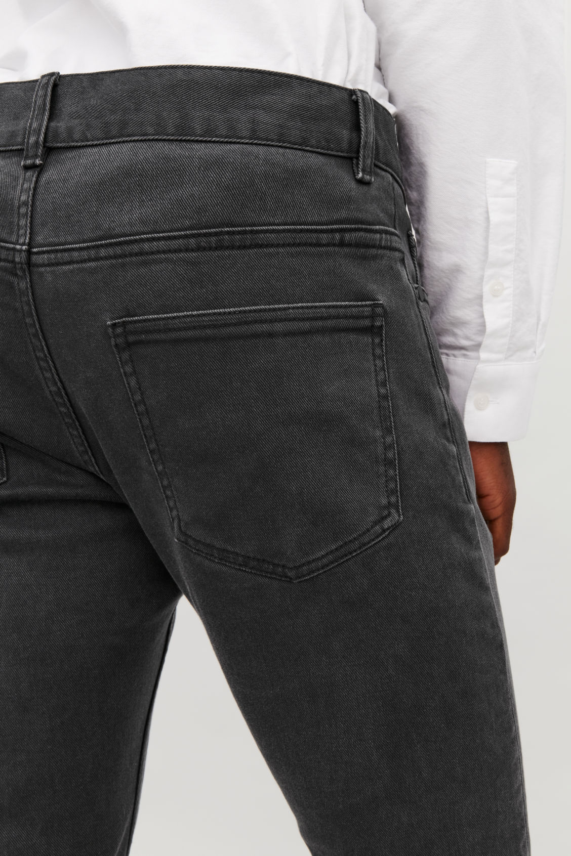 Model side image of Cos slim leg jeans in grey
