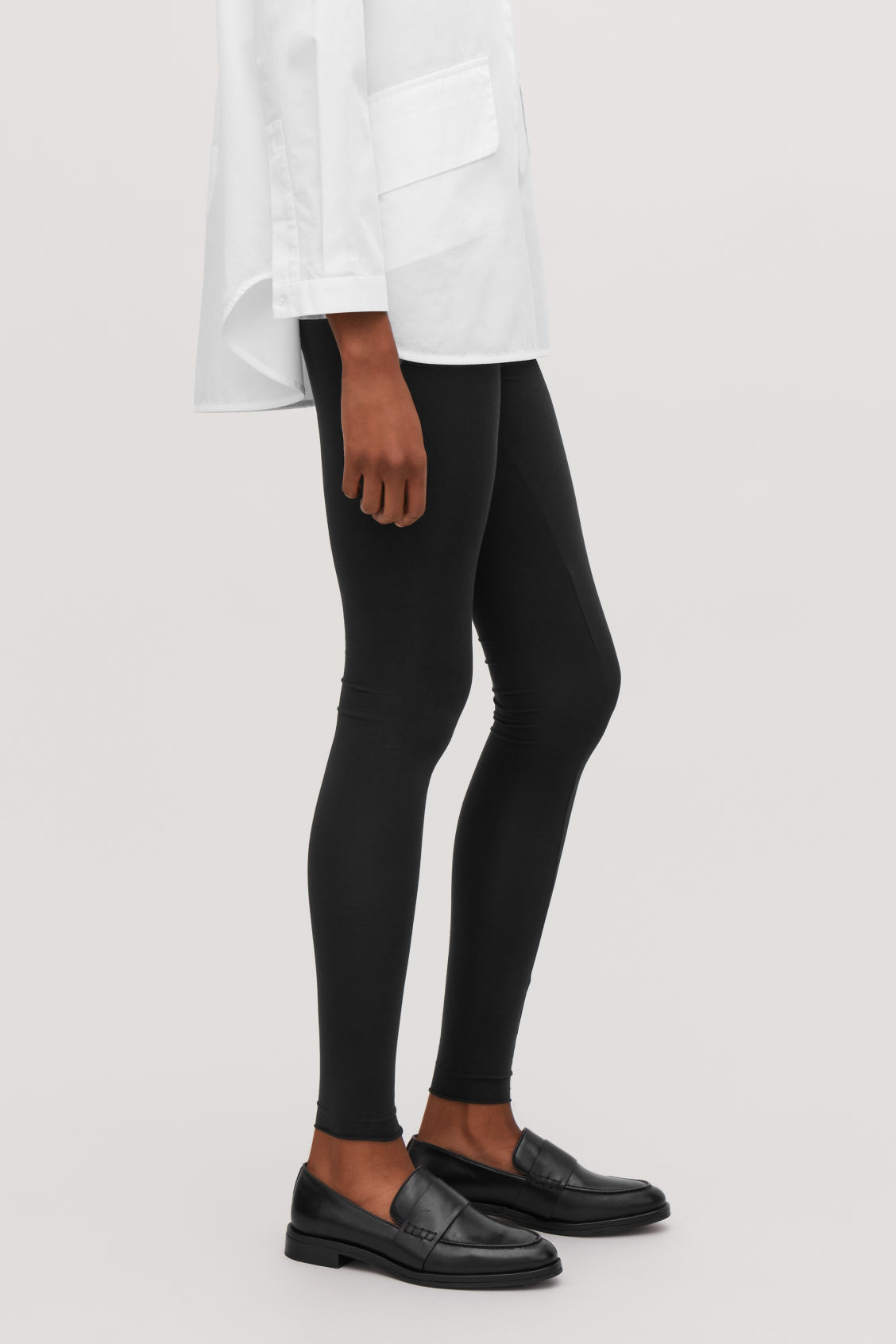 Model side image of Cos elastic-waist leggings  in black