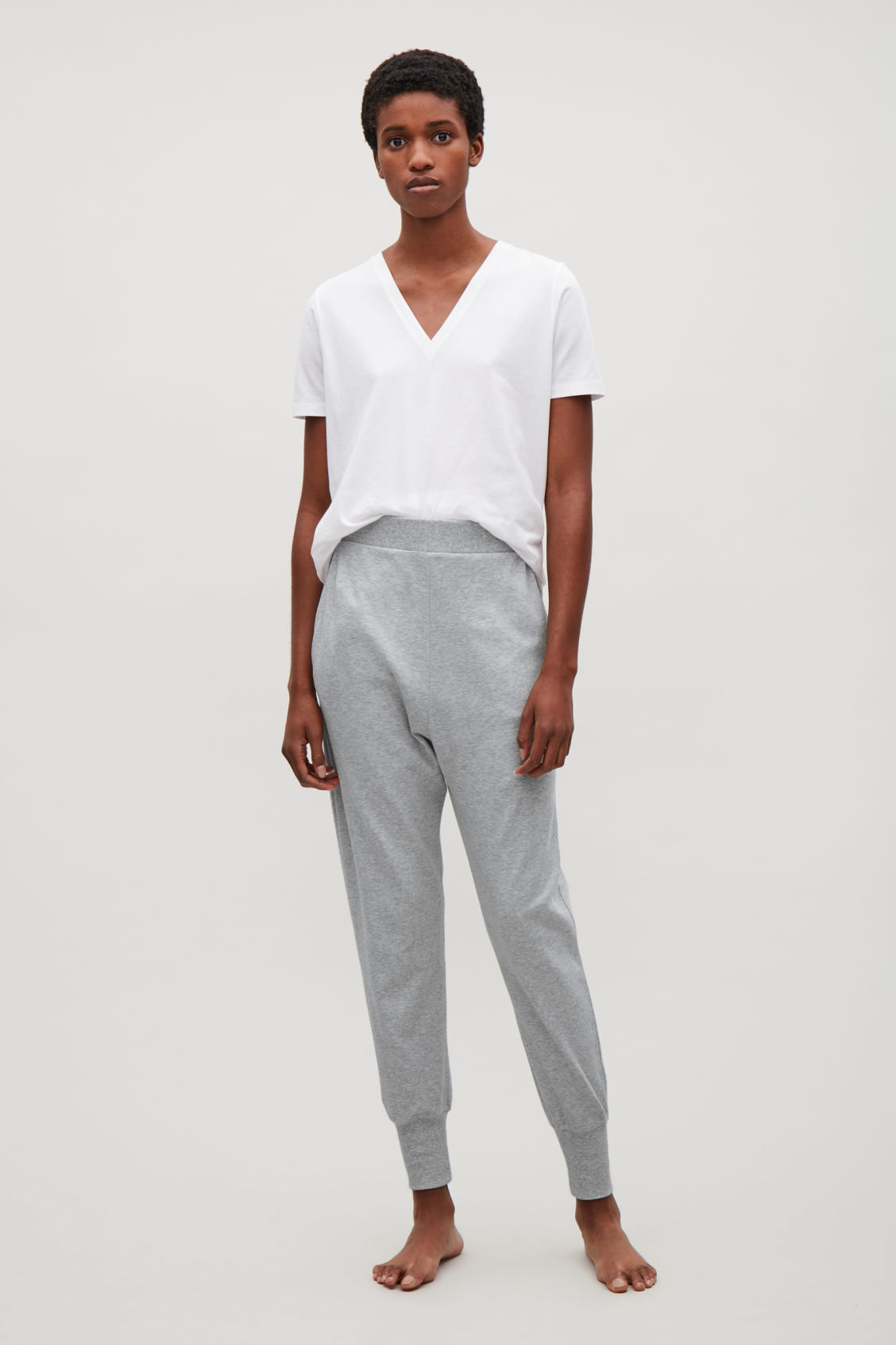 Model front image of Cos tapered jersey trousers in grey