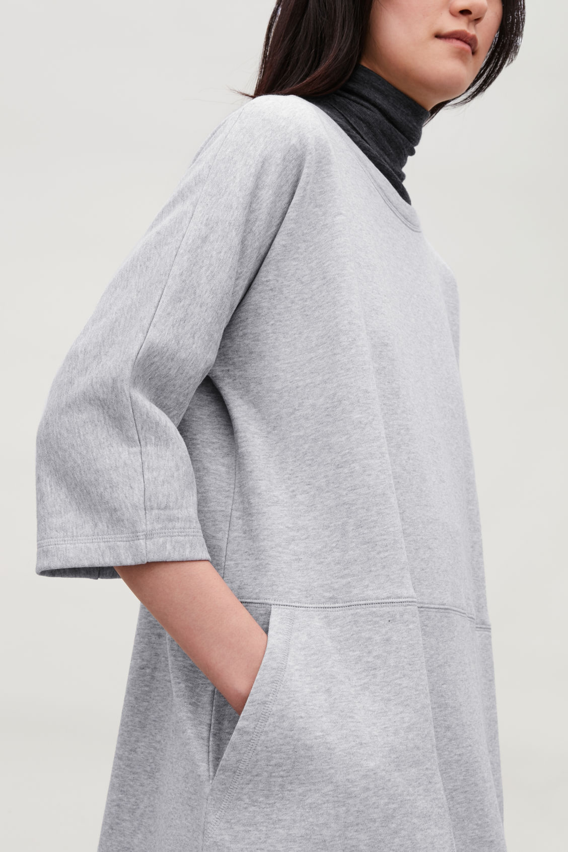 Model side image of Cos patch pocket jersey dress in grey