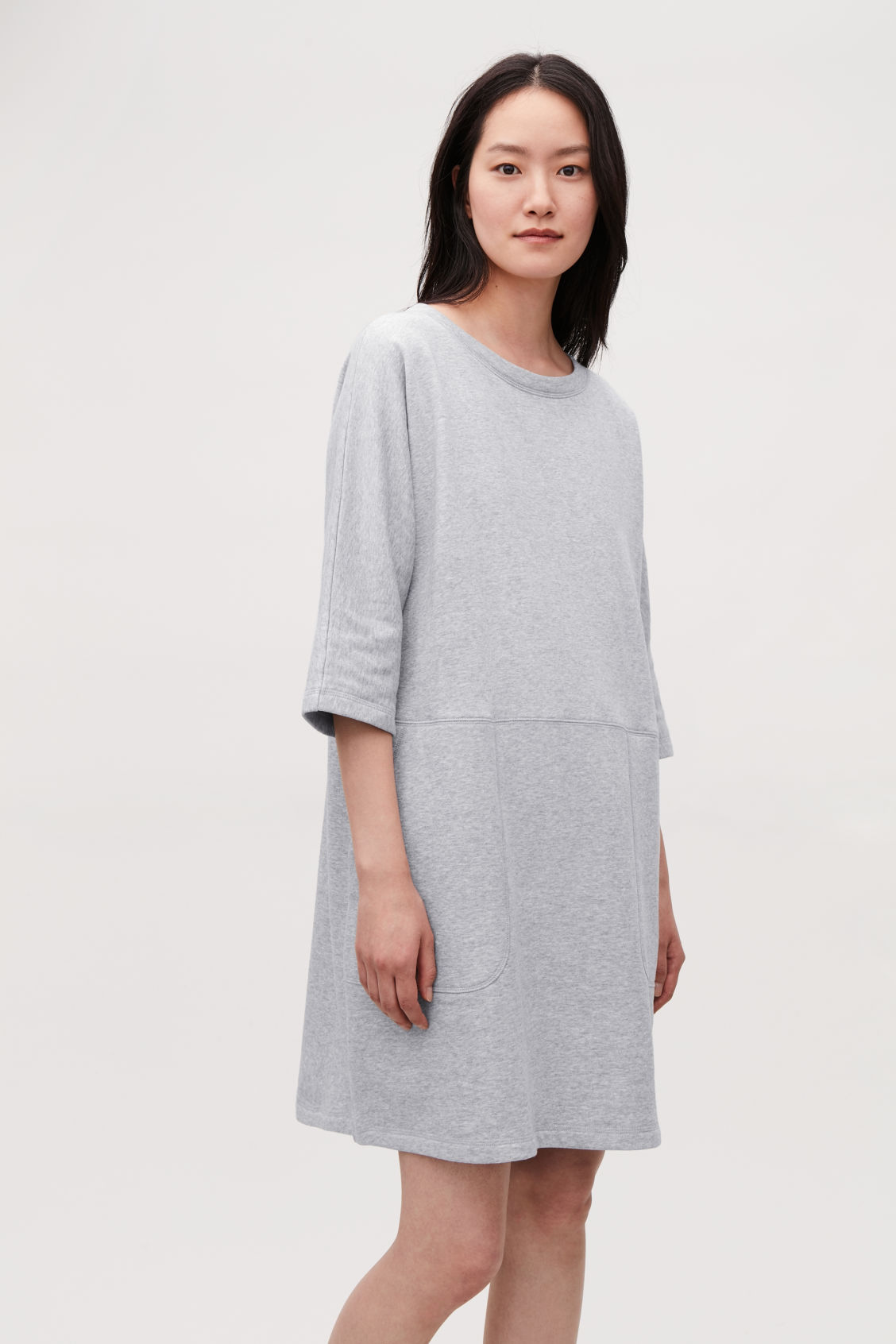 Model side image of Cos patch-pocket jersey dress in grey
