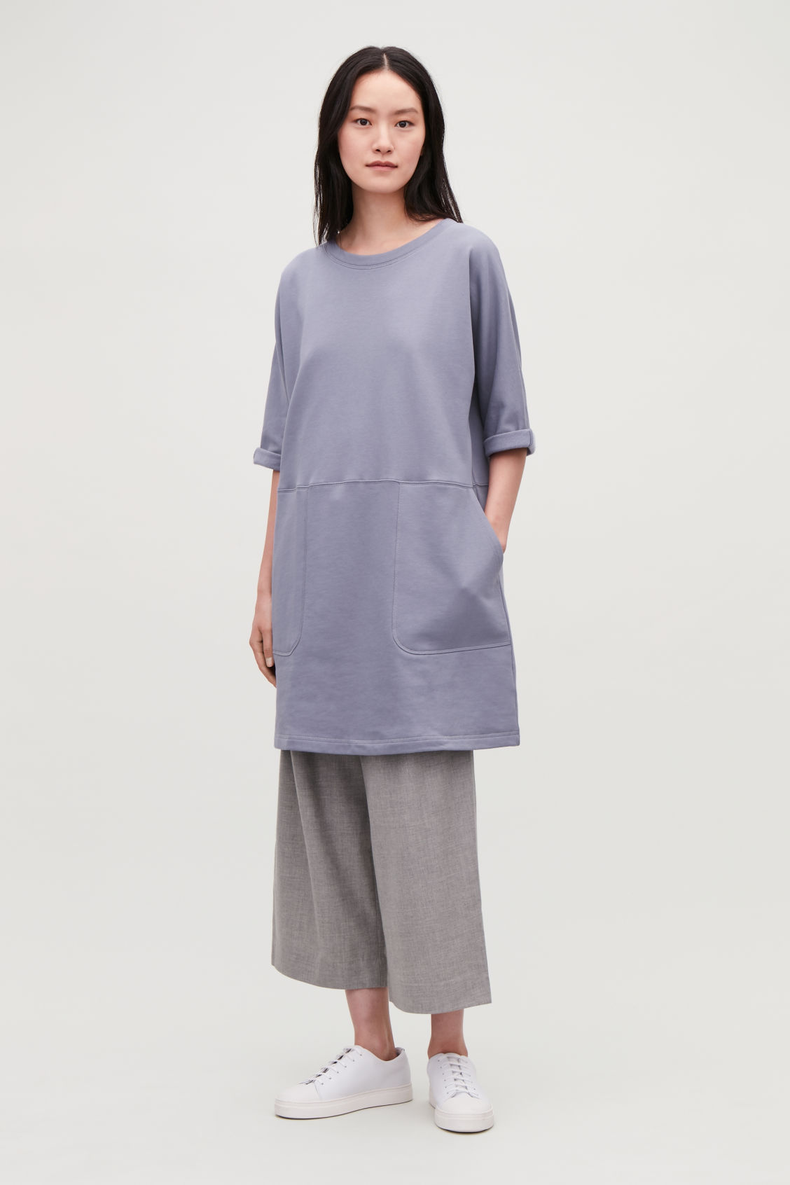Model front image of Cos patch-pocket jersey dress in blue