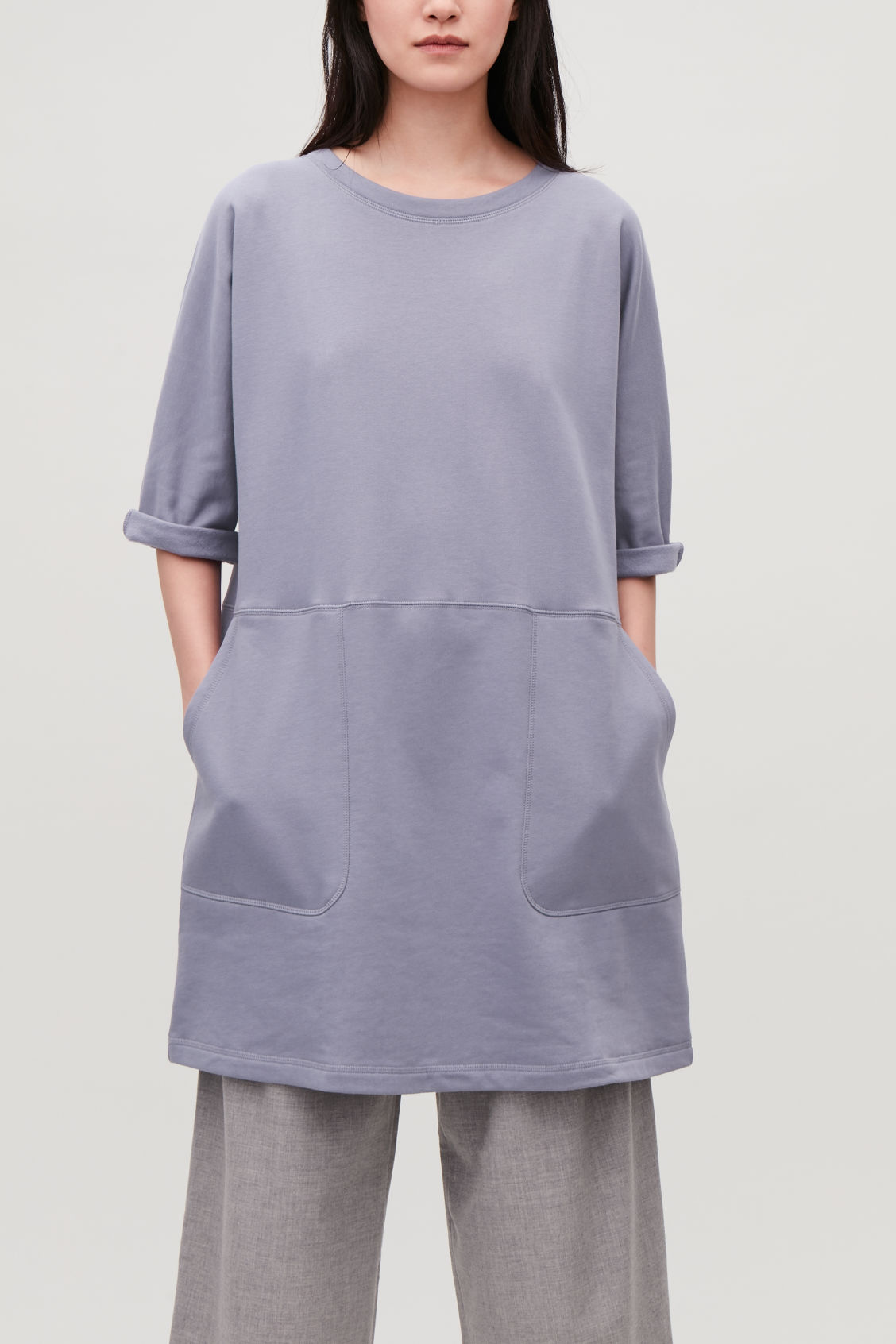 Model side image of Cos patch-pocket jersey dress in blue