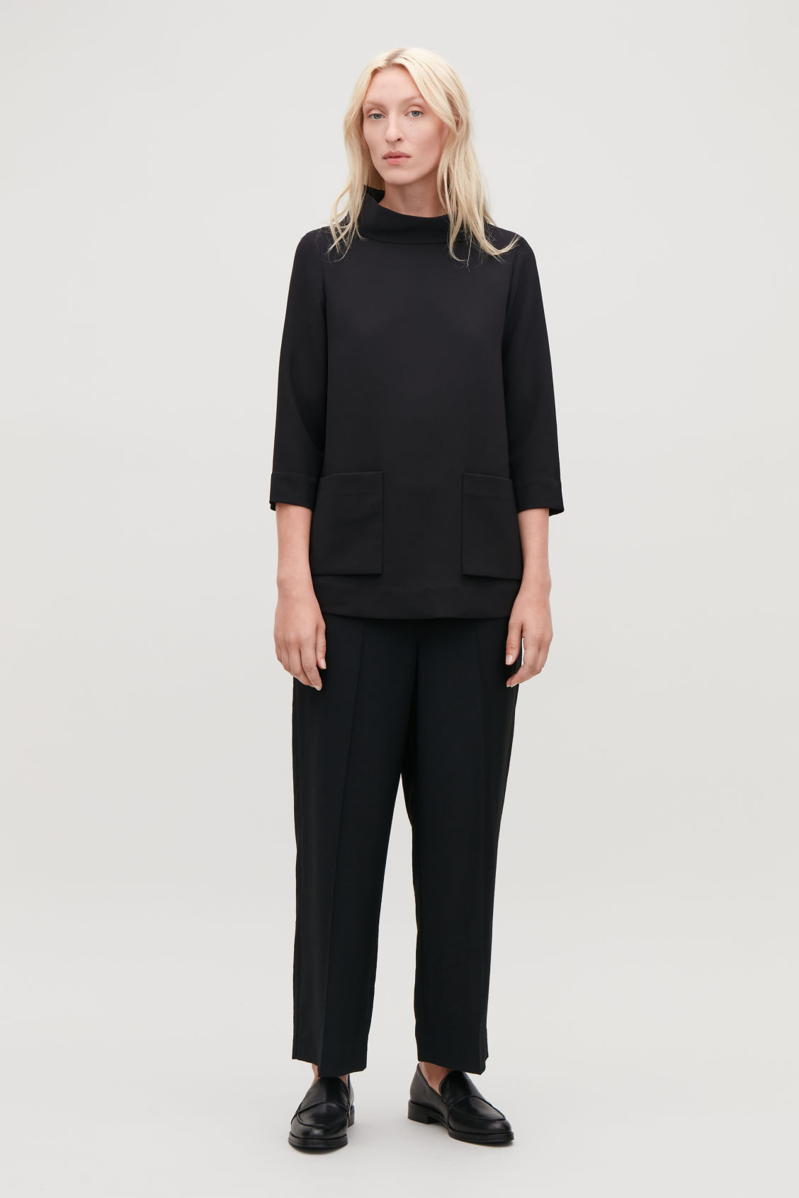 Model front image of Cos top with folded collar  in black