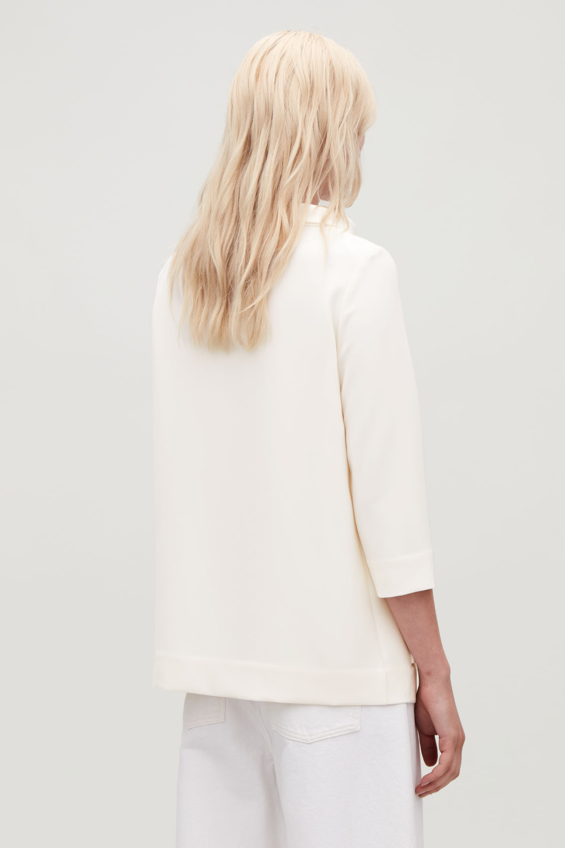 Model side image of Cos top with folded collar  in white