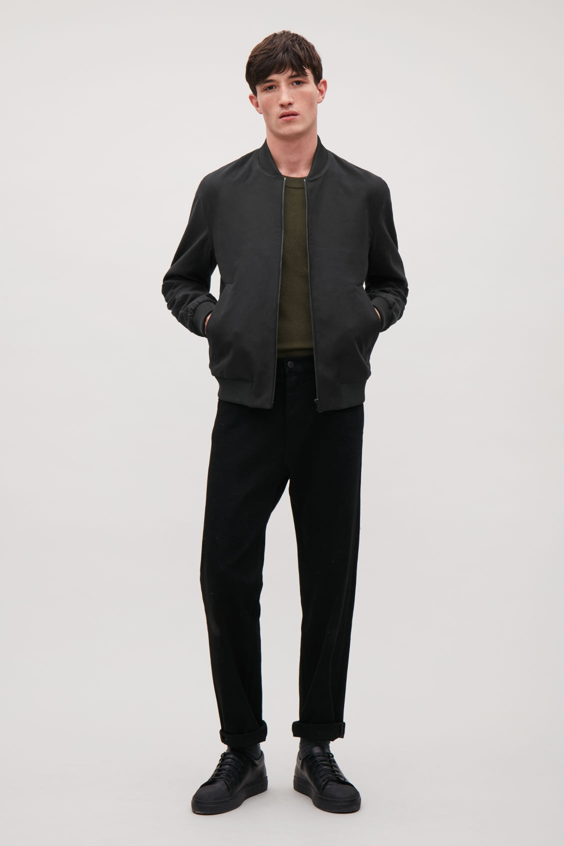 Model front image of Cos bomber jacket with zipped pockets  in black