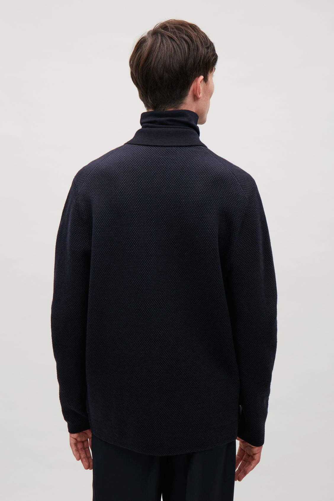 Model side image of Cos structured cardigan in blue