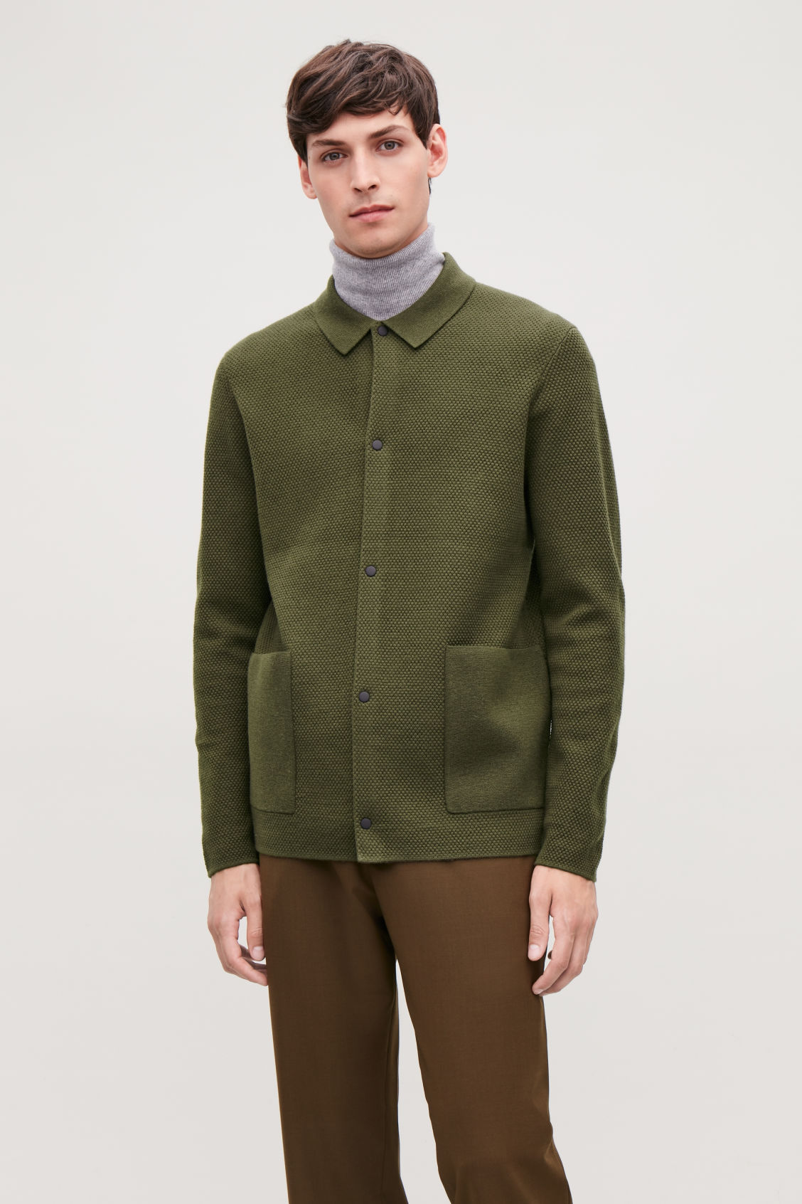 Model side image of Cos structured cardigan in green