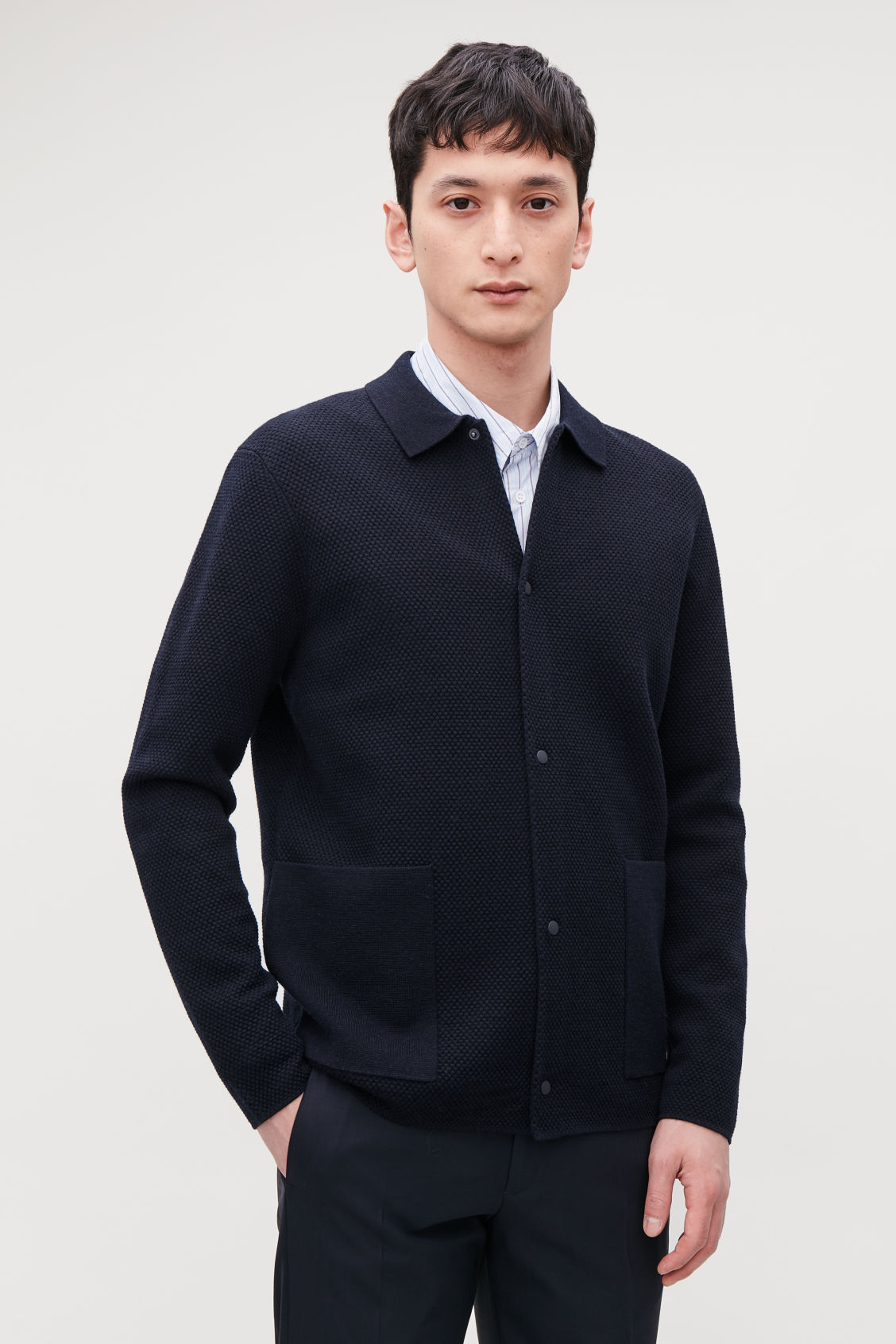 Model side image of Cos structured merino cardigan in blue