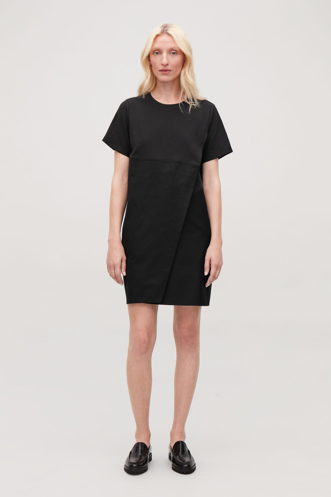 Model front image of Cos dress with overlap front in black