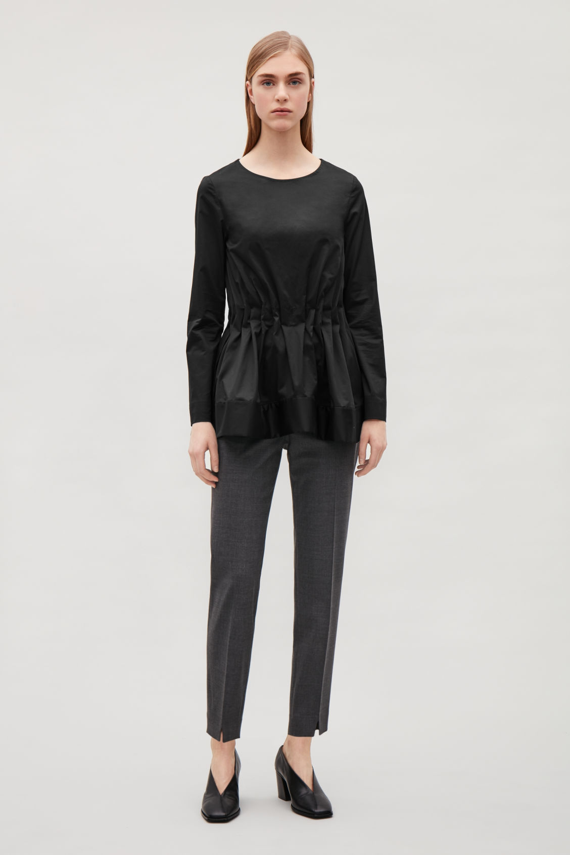 Model front image of Cos top with elastic waist in black