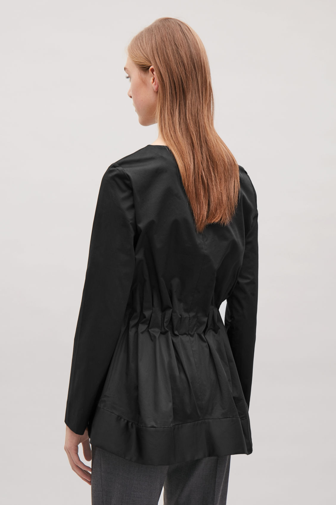 Model side image of Cos top with elastic waist in black