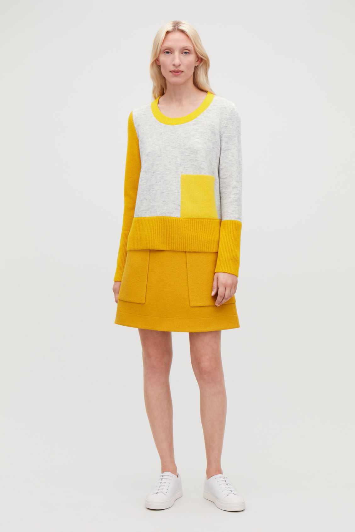 Model front image of Cos colour-block jumper with pocket in yellow