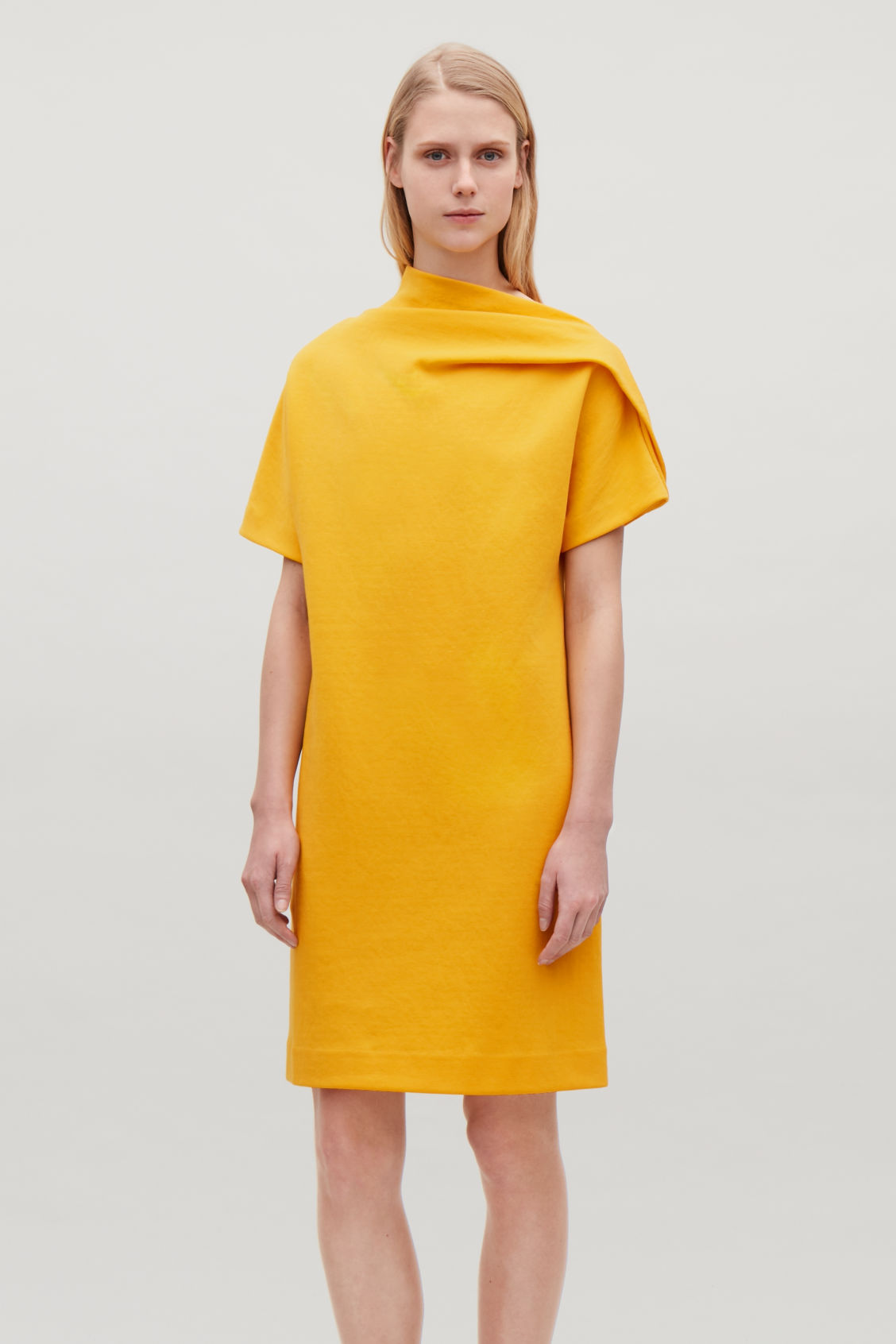 Model side image of Cos jersey dress with drape  in yellow