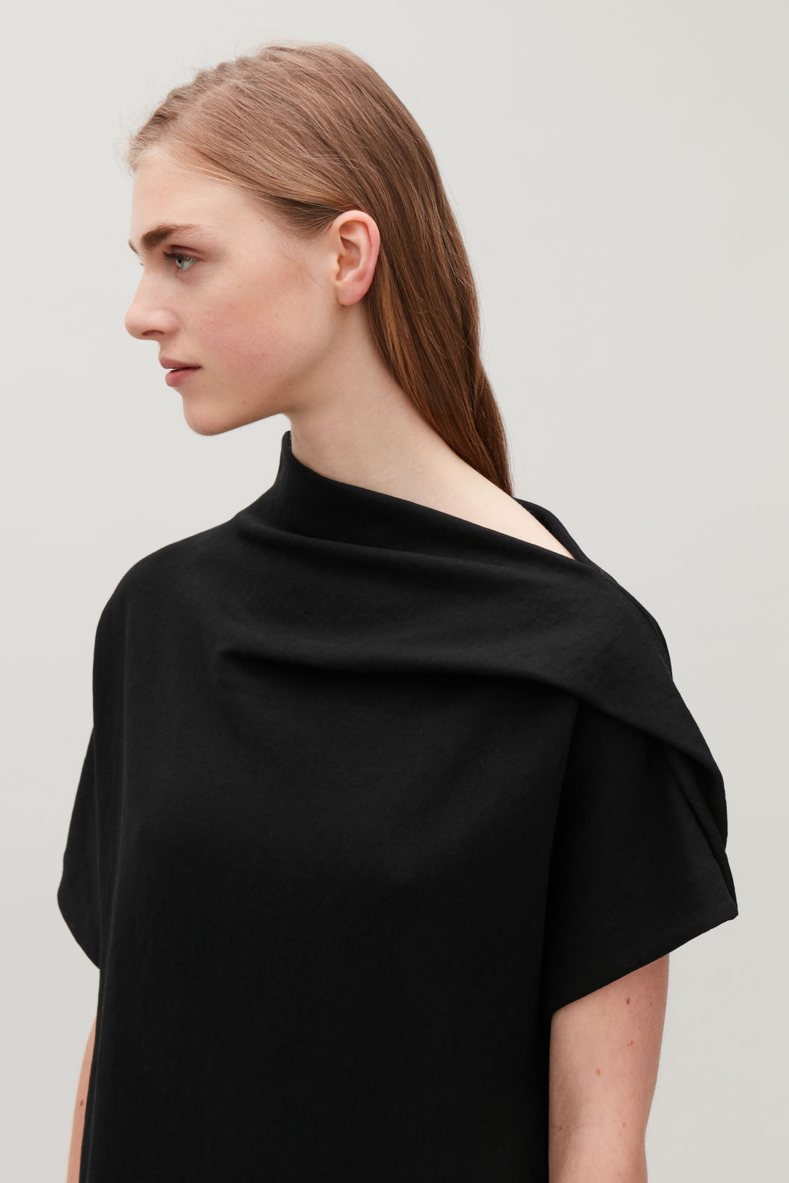 Model side image of Cos draped-neck jersey dress in black