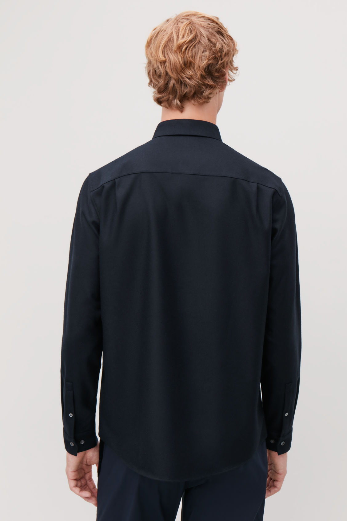 Model side image of Cos felt wool shirt  in blue