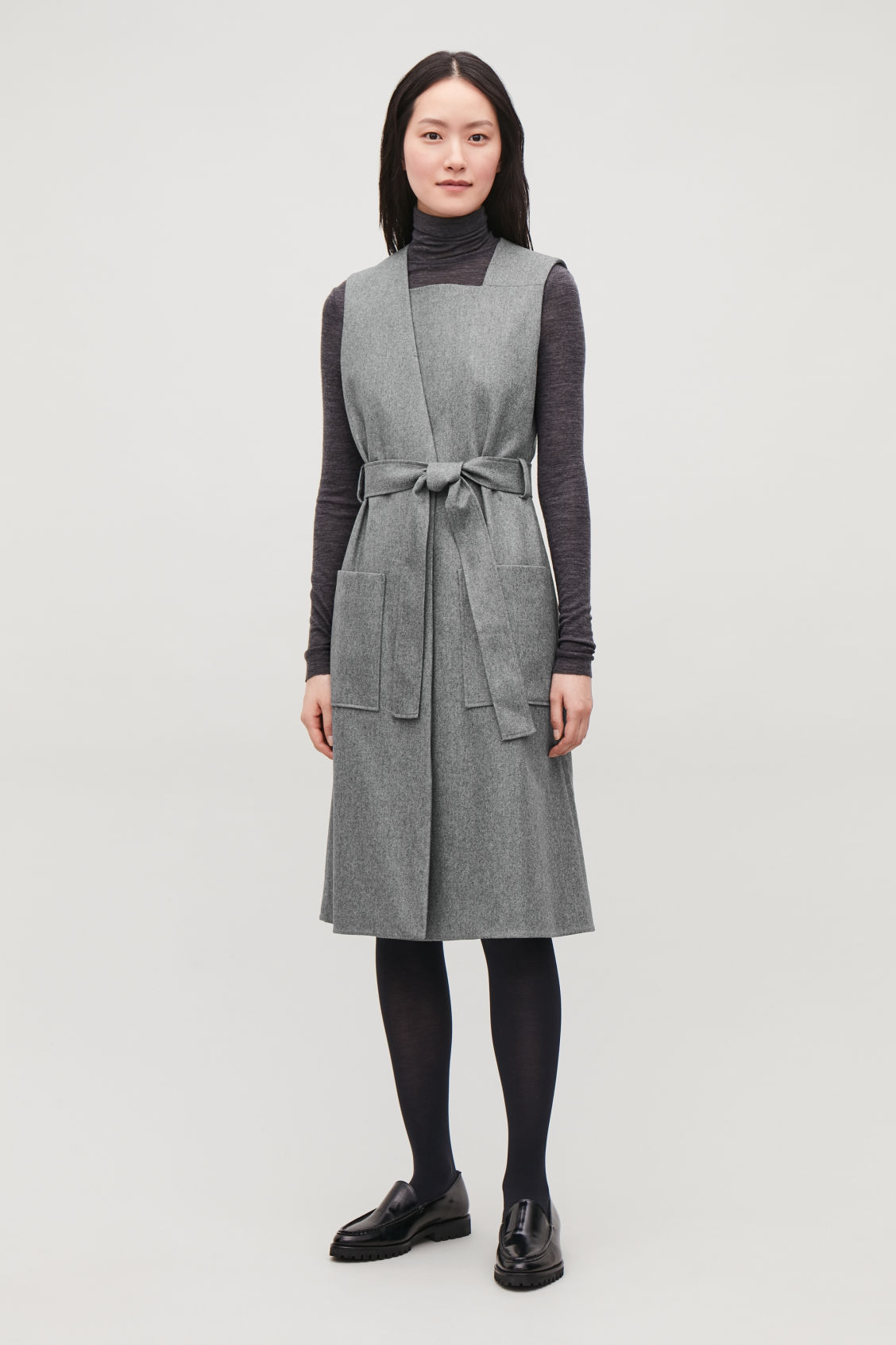 Model front image of Cos sleeveless wrap dress with belt in grey