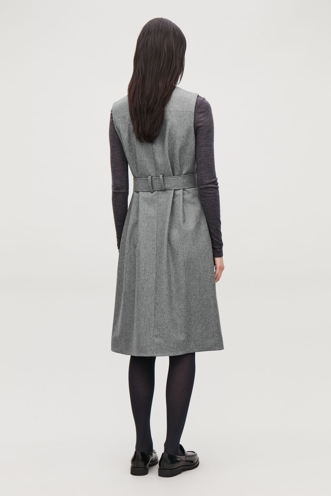 Model side image of Cos sleeveless wrap dress with belt in grey