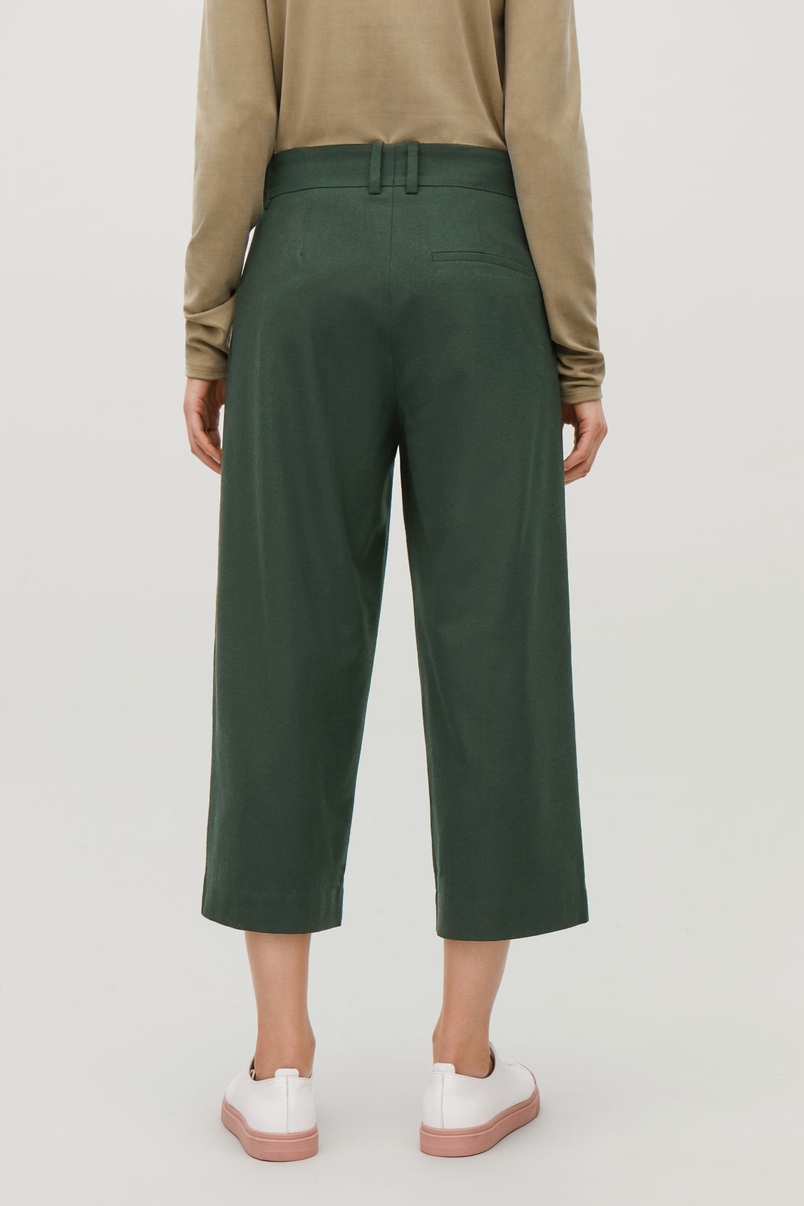 Model side image of Cos wide-leg flannel trousers  in green