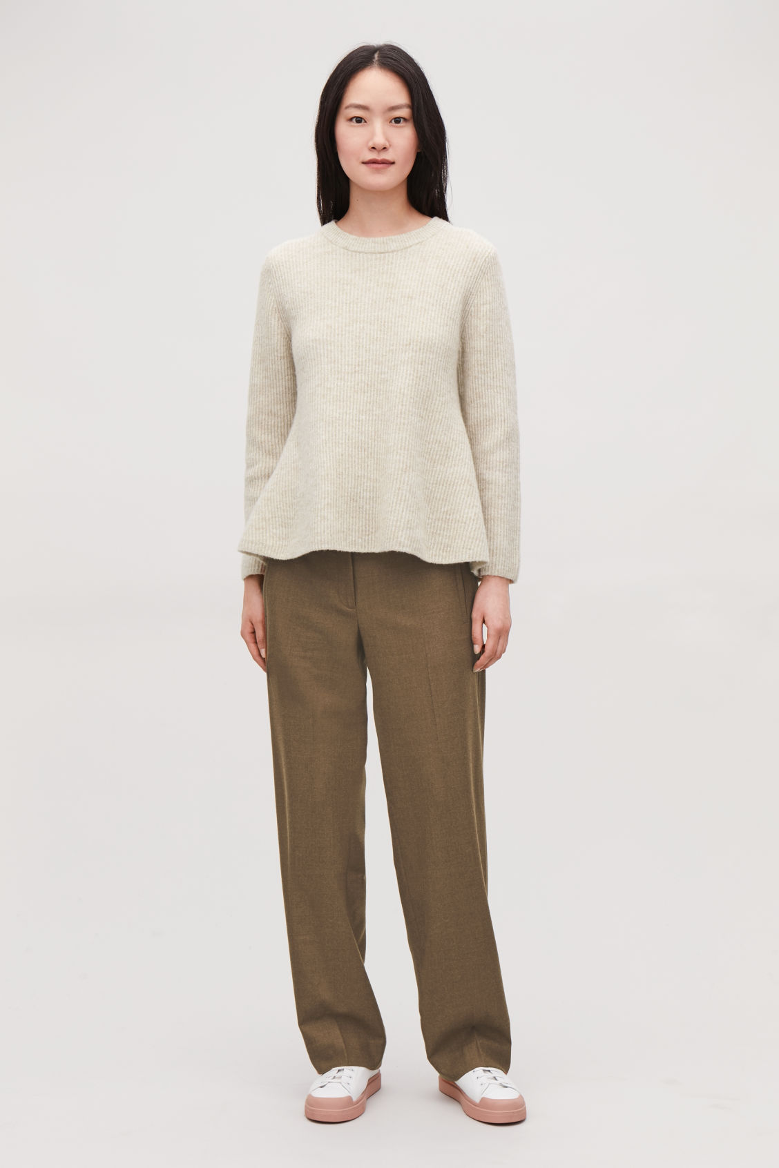Model front image of Cos waisted peplum jumper  in beige