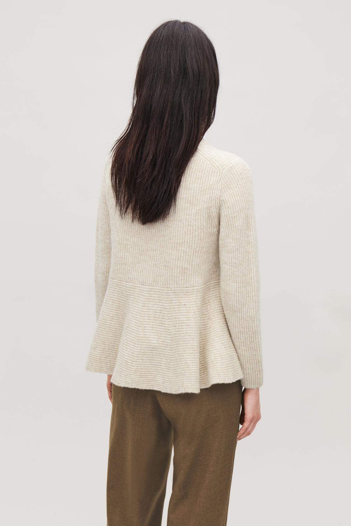 Model side image of Cos waisted peplum jumper  in beige