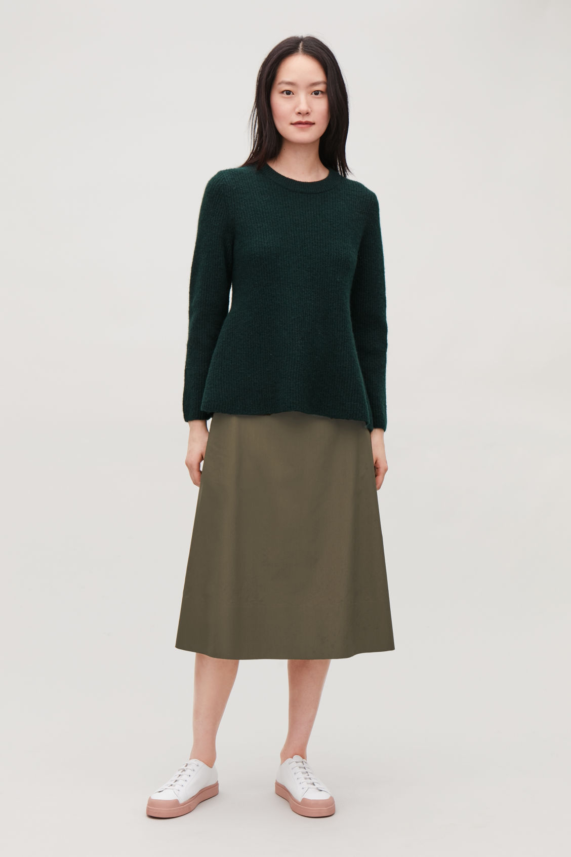 Model front image of Cos waisted peplum jumper  in green