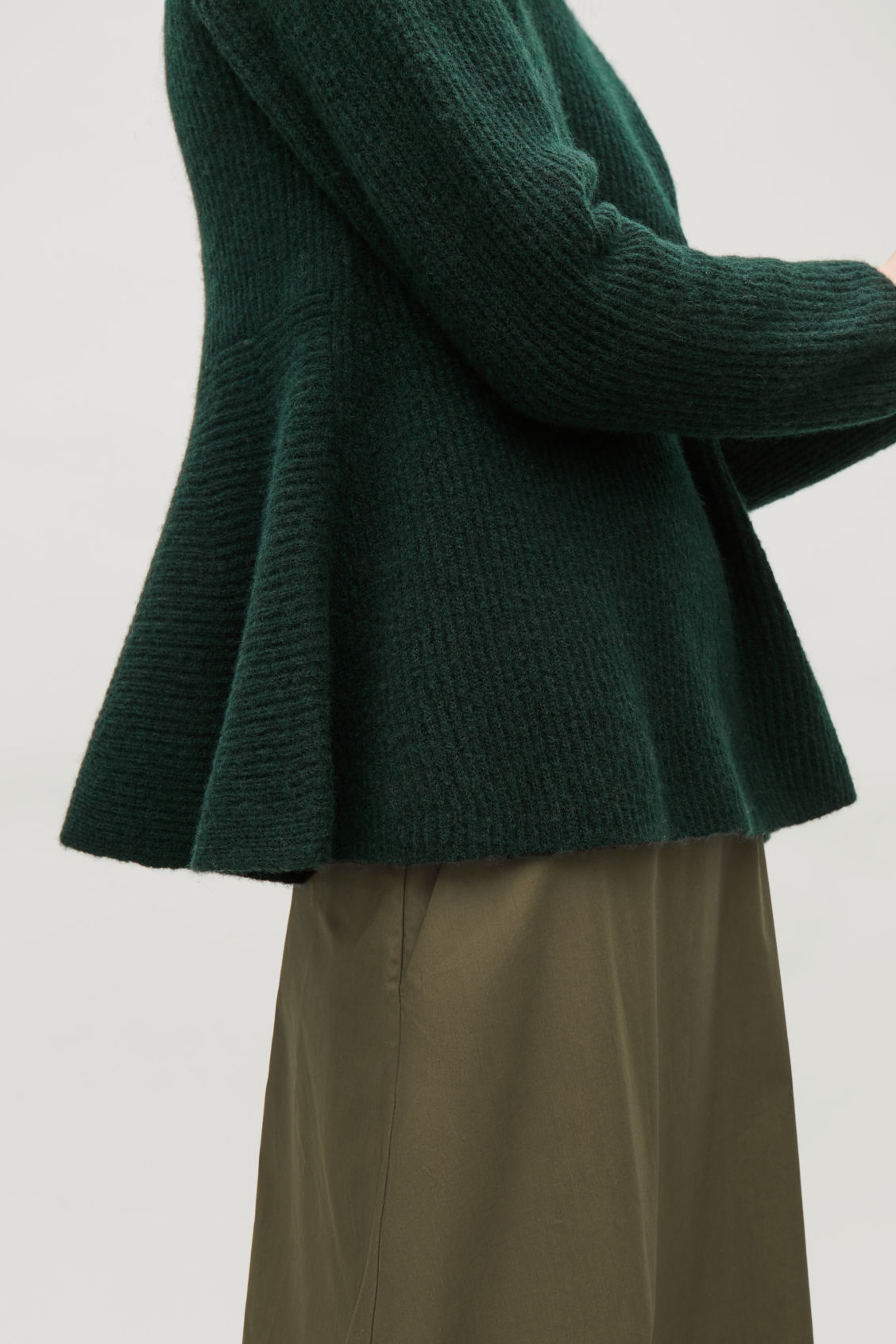 Model side image of Cos waisted peplum jumper  in green