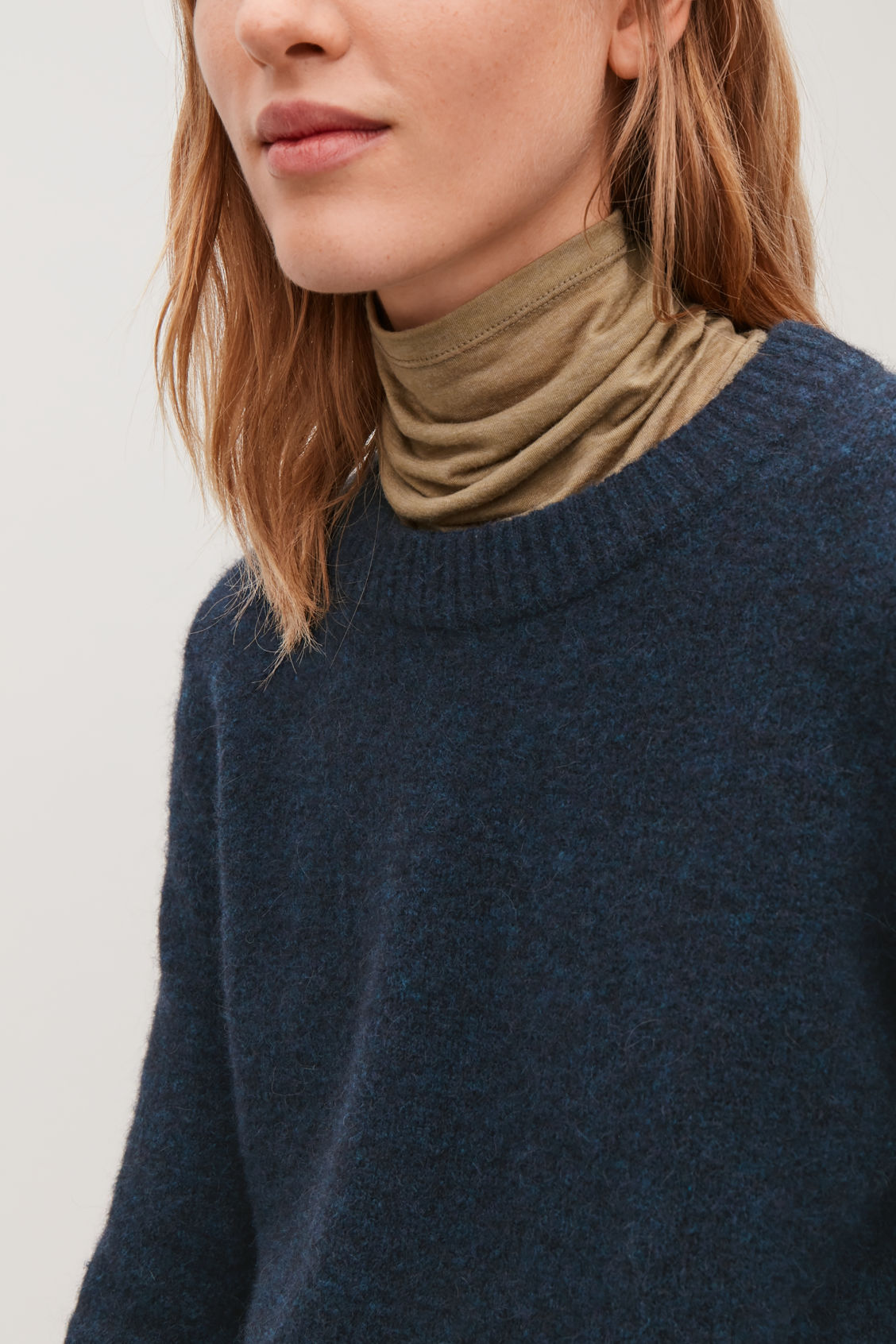 Model side image of Cos alpaca and wool jumper  in blue